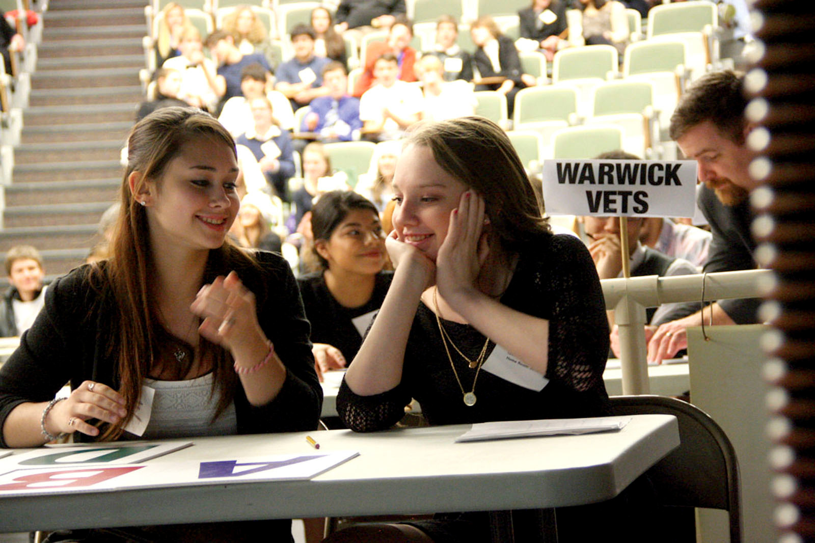 WINNING SMILES: Vets team members Casidy Melo and Cailey Noble share a smile after correctly answering a question in the Rhode Island Academic Decathlon Super Quiz Sunday.