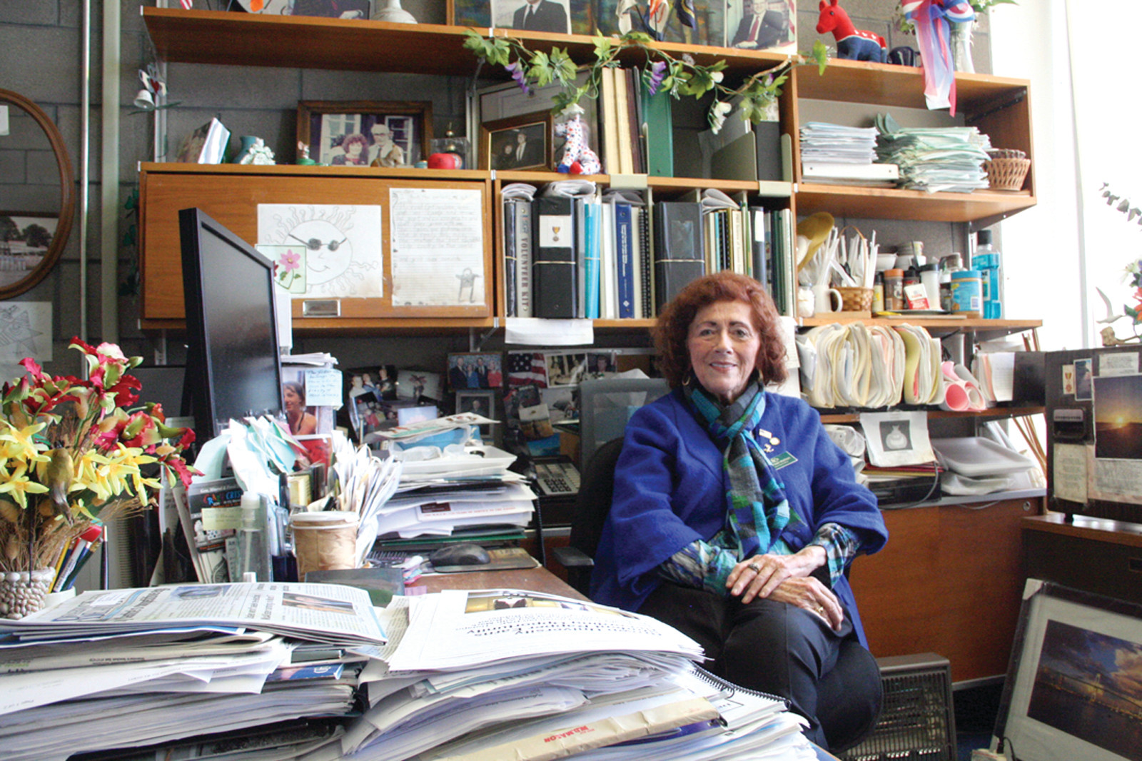 OFFICE FULL OF MEMORIES: Edna O'Neill Mattson is seen in her CCRI office that is filled with photographs and mementoes from her many years of community and political involvement.
