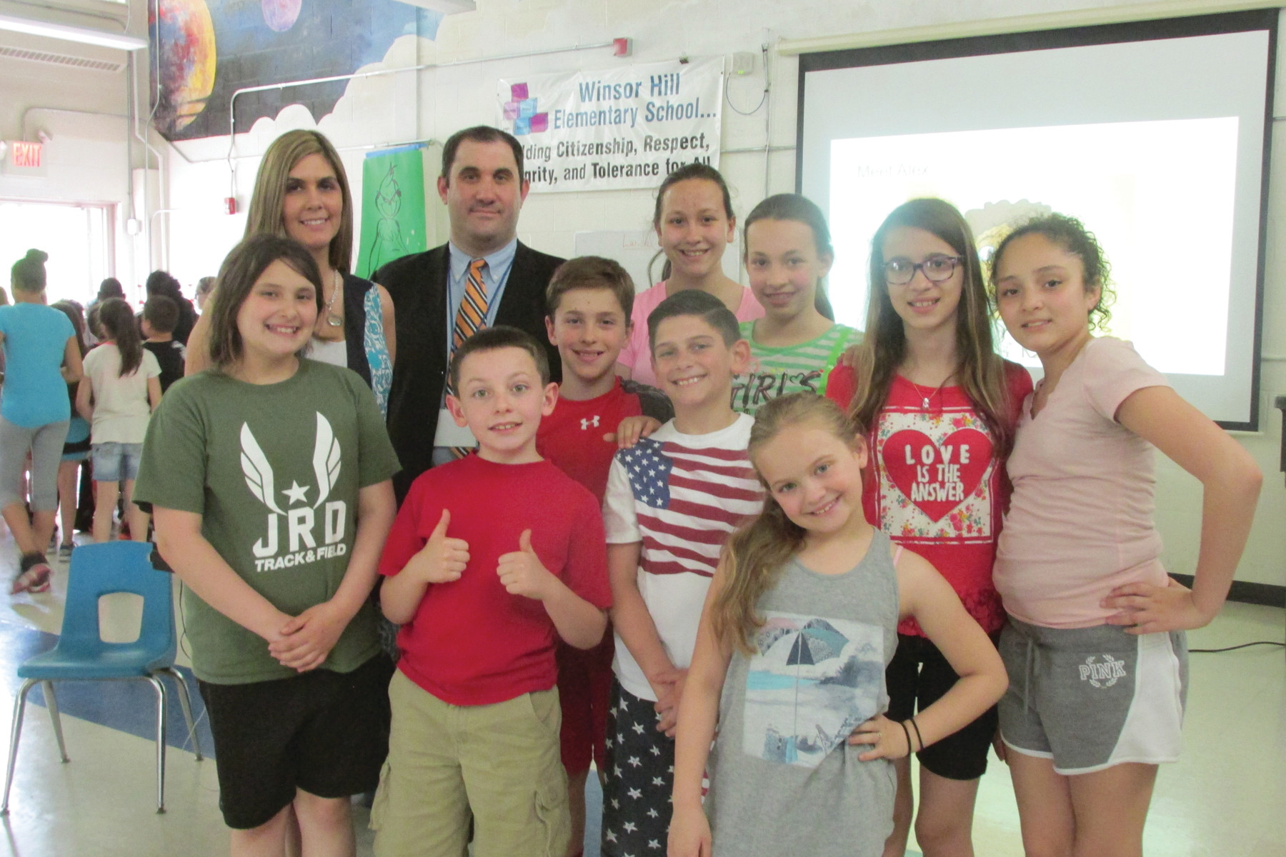 HEALTHY KIDS DAY: Winsor Hill Elementary School Principal Michele Zarcaro and Detective Eric Baccari are joined by students after last Thursday's Healthy Kids Day.