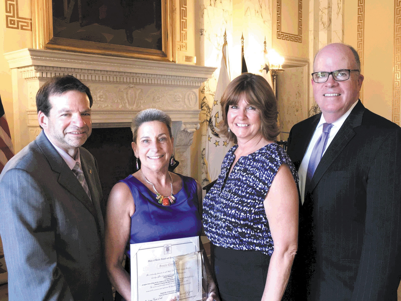 ELDER JUSTICE HERO: Cheryl Patnaude was awarded the Elder Justice Hero Award on Elder Abuse Awareness Day, June 15, at a ceremony at the State House. From left are Steve Horowitz, president and CEO Saint Elizabeth Community, Patnaude, Kathy Parker Director of admissions Saint Elizabeth Community and Charles Fogarty director of the division of elderly affairs.