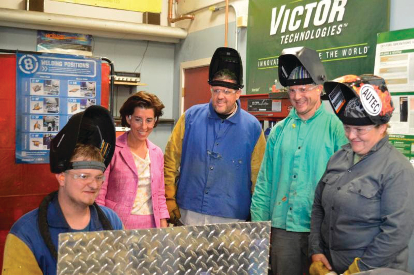 NEIT TOUR: After the unveiling of the new strategic workforce development plan, Governor Gina Raimondo toured New England Institute of Technology's welder program. Here, she watches several welding students at work.
