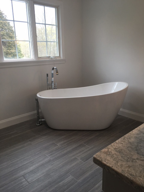 To see more remodeled bathroom such as this spectacular one constructed by the talented team at McCormick's Home Improvement, Inc, visit their website at www.MHI-RI.com or call for your free consultation today at 463-7674.