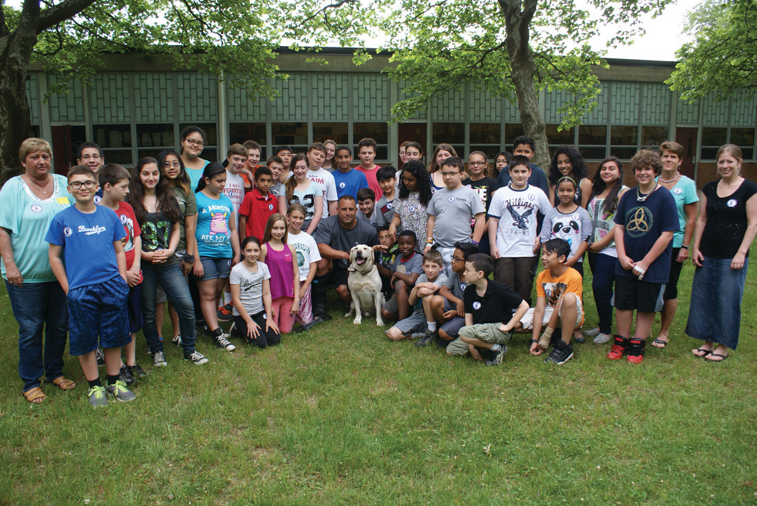 AT EDEN PARK: Pictured are both sixth-grade classes at Eden Park Elementary School in 2014 posing for a photo with Officer Gregg Bruno and K-9 Bosco.