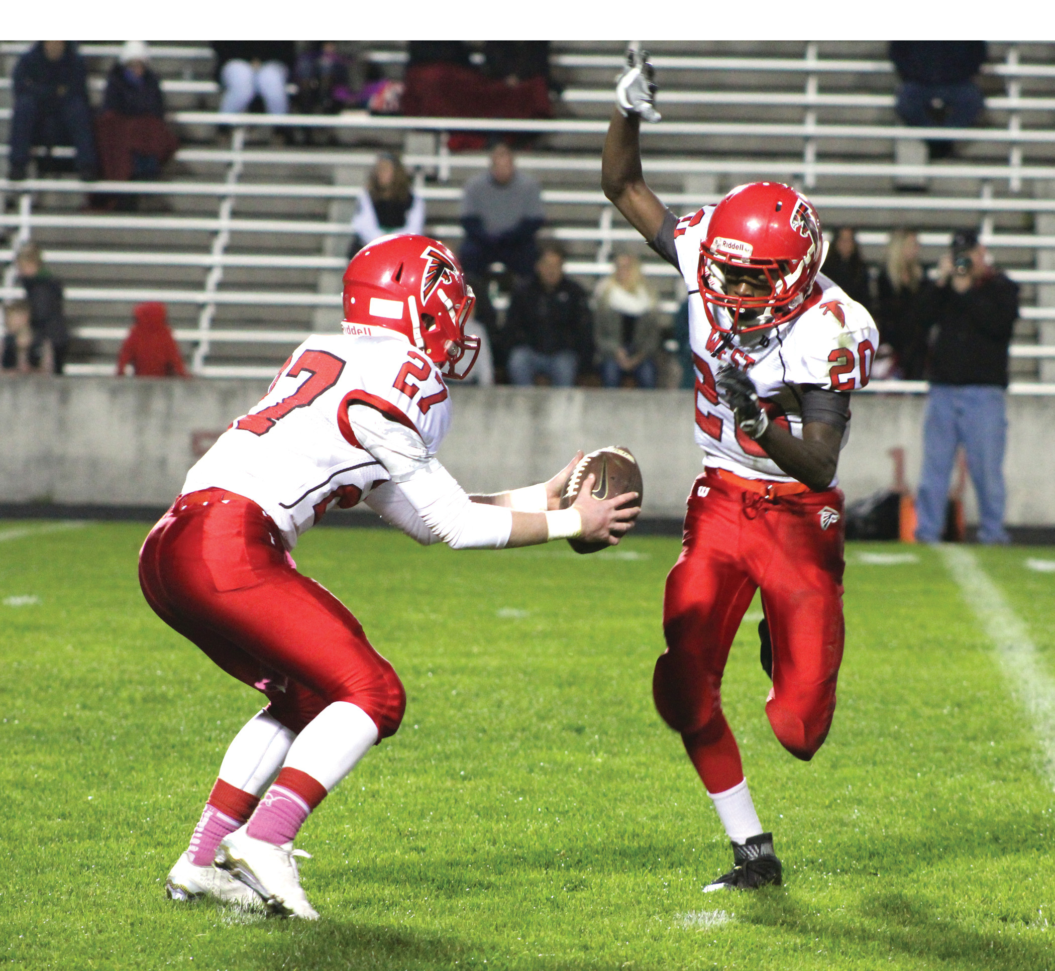 RUNNING THE OFFENSE: West quarterback Cam Harris fakes a handoff to Josh Pereira on Friday night.