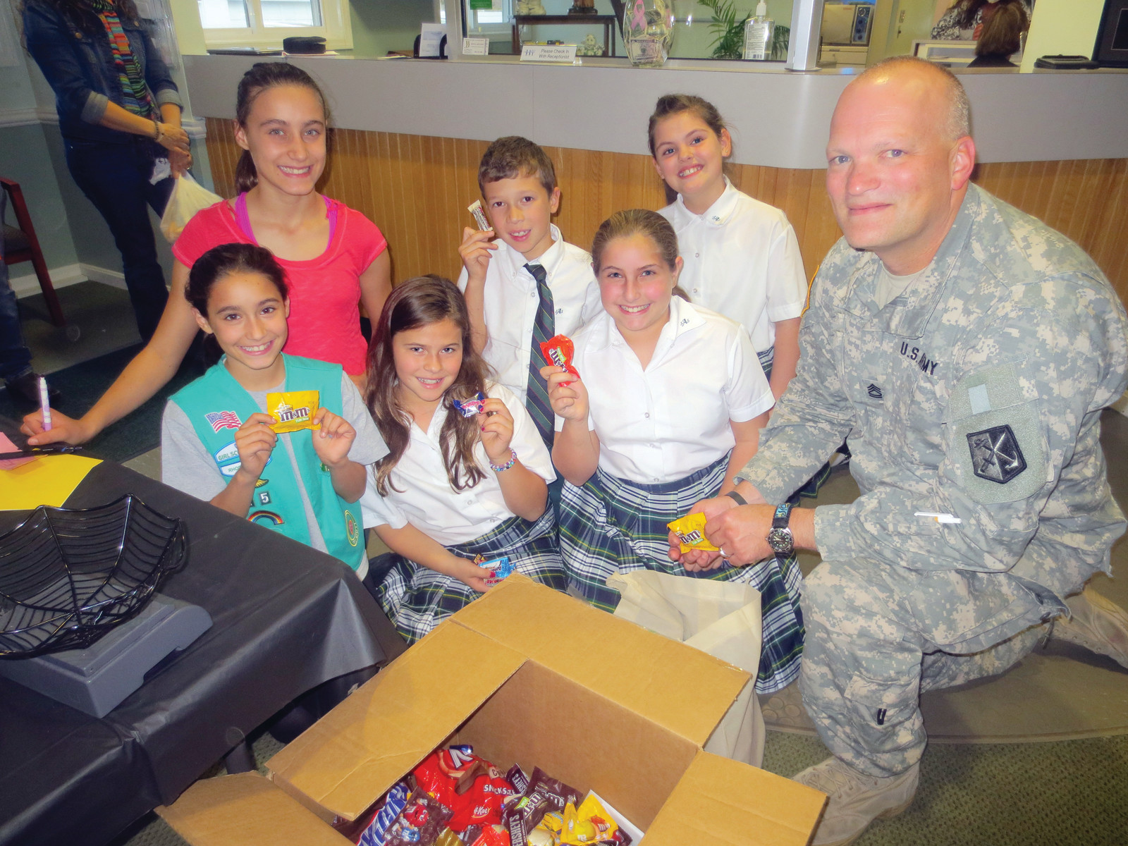 "Every year, Dental Arts Group participates in an after-Halloween candy collection program which help support our troops, such as Soldier's Angels ""Treats for Troops"" ~ just like in this photo taken during last year's drive."