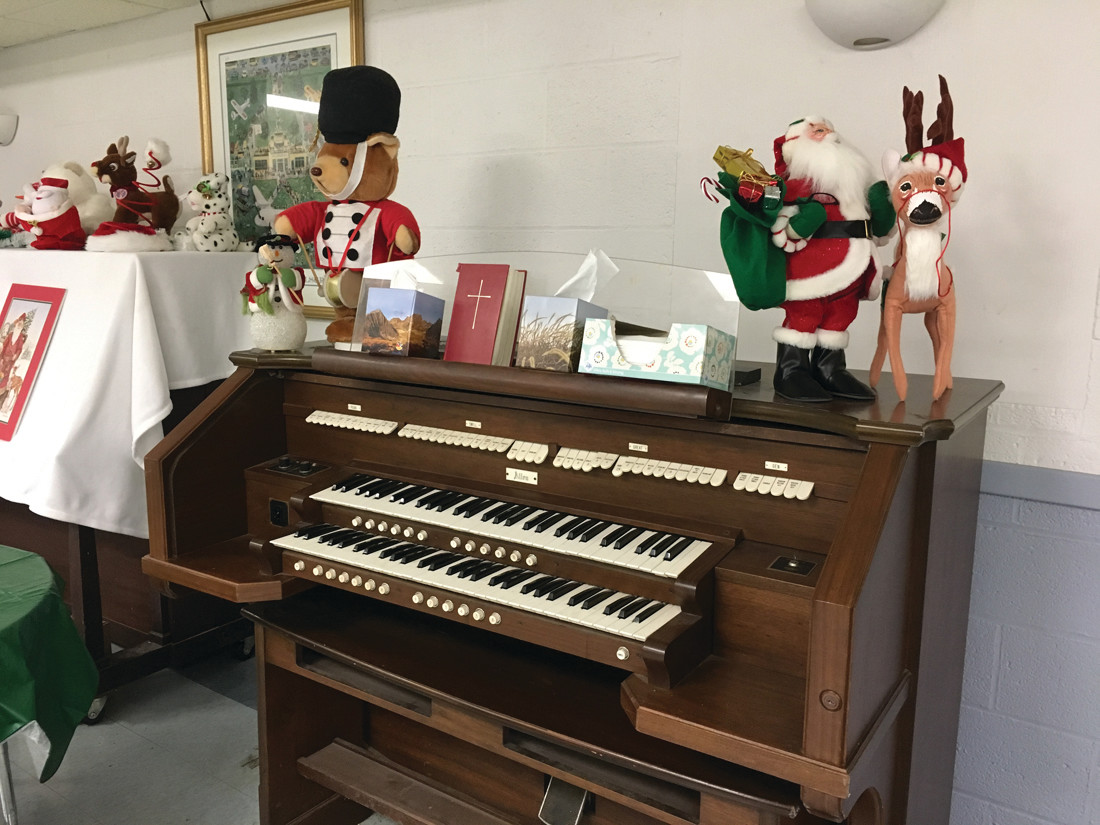 IN NEED OF AN OWNER: This manual Allen organ is one of two organs Trinity Episcopal Church is looking to give away in return for a donation to the church.