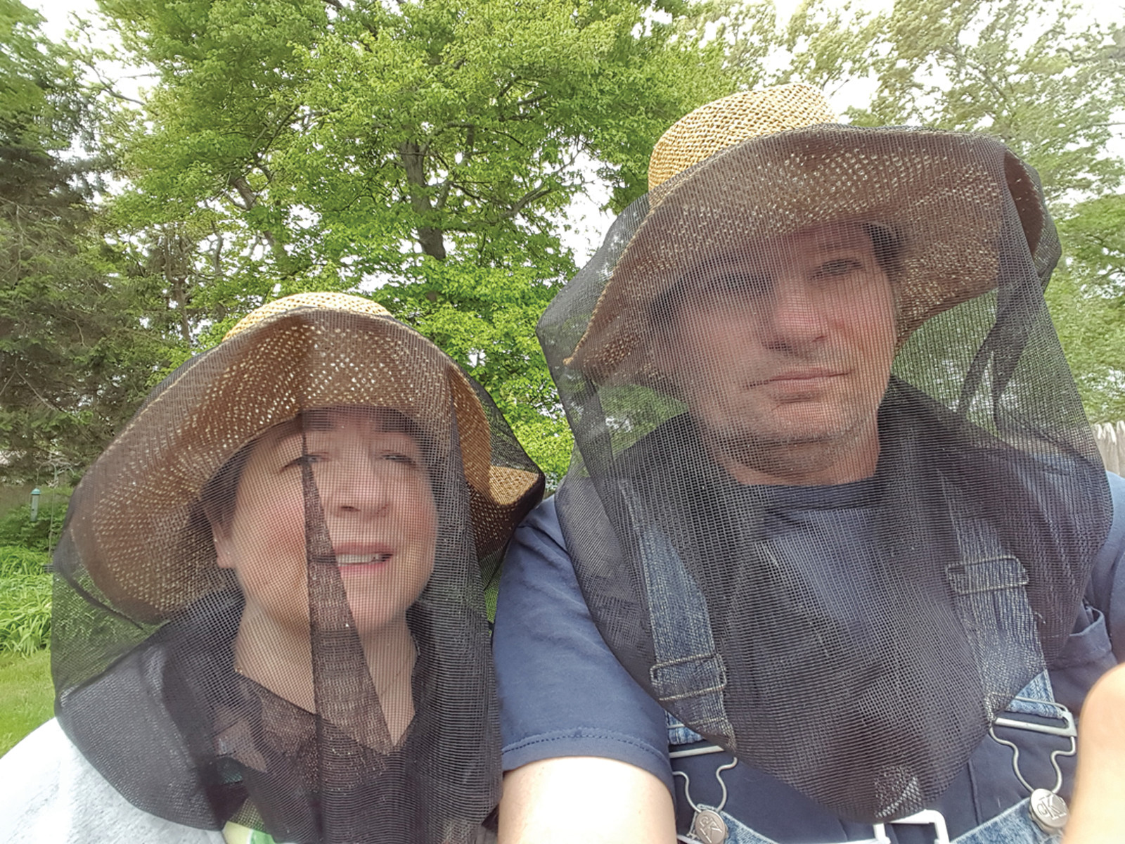 PLAYING IT SAFE: Jim and Sandra Suttles of Warwick started beekeeping about a year ago. They plan to expand with a second hive this year.