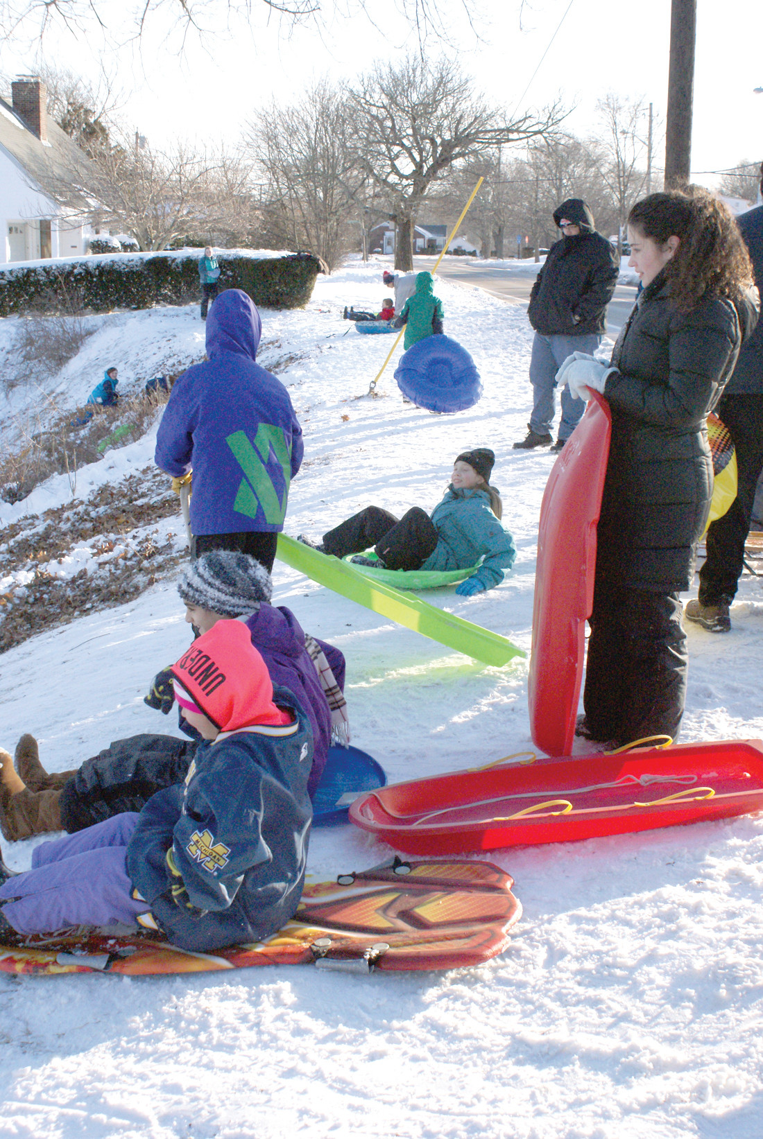 LAUNCH PAD: Children of all ages gathered on Narragansett Parkway in Warwick to take sled rides down the hill.