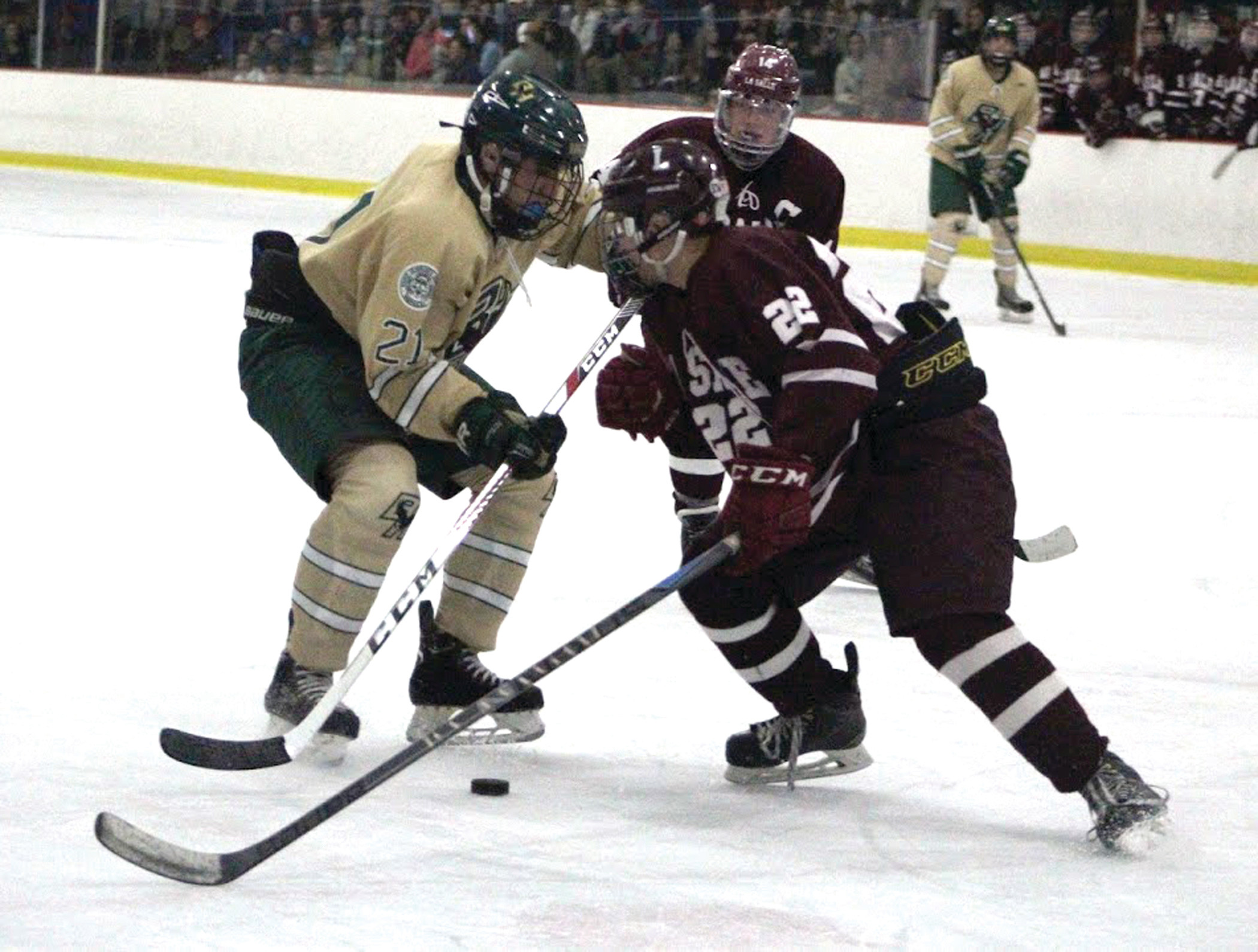 STALEMATE: Hendricken forward Andrew Hopgood tries to get by La Salle defenseman John Cardi. A late La Salle goal sent the game to overtime on Friday, but the bitter rivals would ultimately settle for a tie.