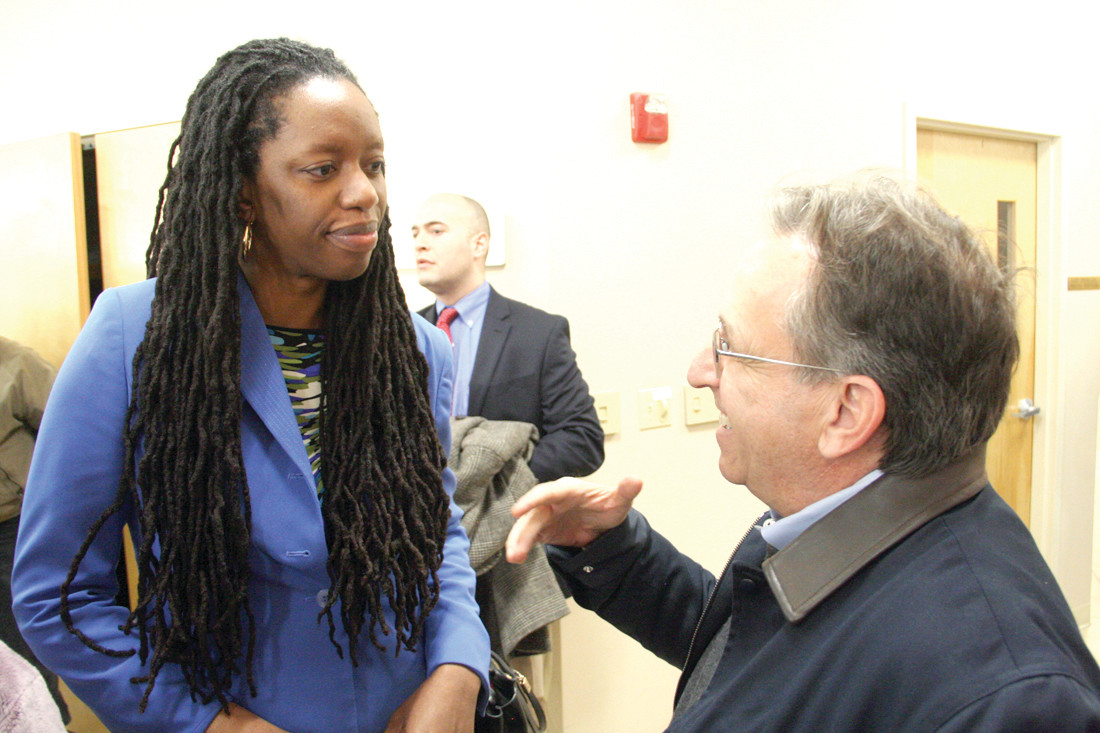 HEALTH IS ON THEIR MINDS: Dr. Nicole Alexander-Scott, director of the state Department of Health, and Sen. Josh Miller of Cranston talk about health issues at Sunday's rally.