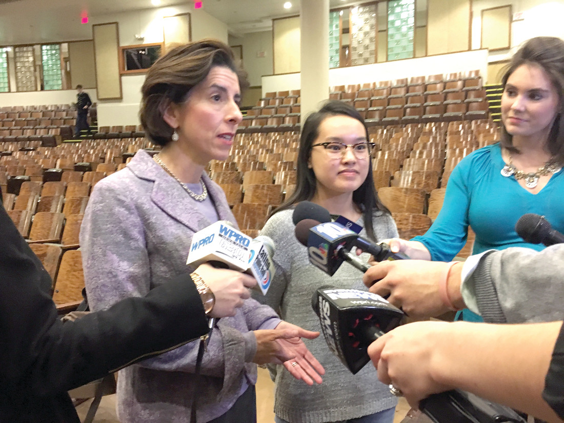 ALL THE DETAILS: Governor Gina Raimondo, pictured above speaking with media at her State of the State, visited Cranston East last week to discuss her idea for free college.