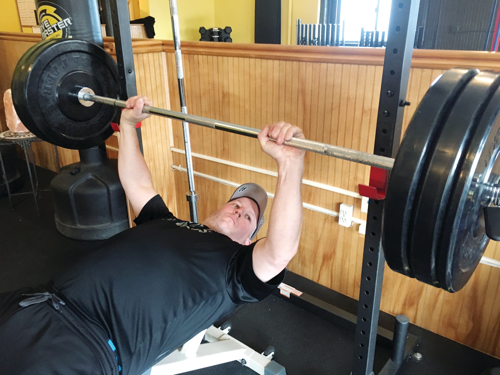 Warwick resident Rob McAllister seems to lift this 300 lb. weight with apparent ease as he works out at the busy fitness center, Infinity Fitness and Wellness in Cranston.