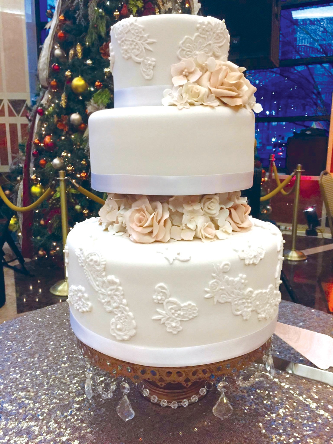SIMPLE ELEGANCE: Rachel Marchetti of Rachel's Sugar Shop created a cake that coordinated with the bride's gown.