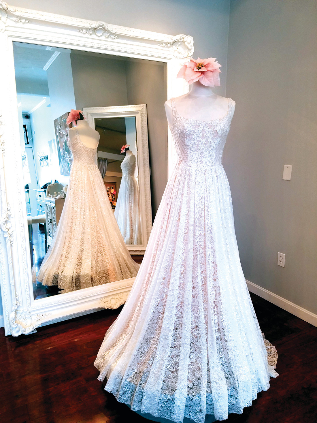 COMFORT FOR THE BRIDE: Spark Bridal Outlet on Cranston Street carries a 2017 Oksana Mukha design, a soft, flowing, and comfortable gown created from an ivory lace with a sheer cappuccino-colored underlay.