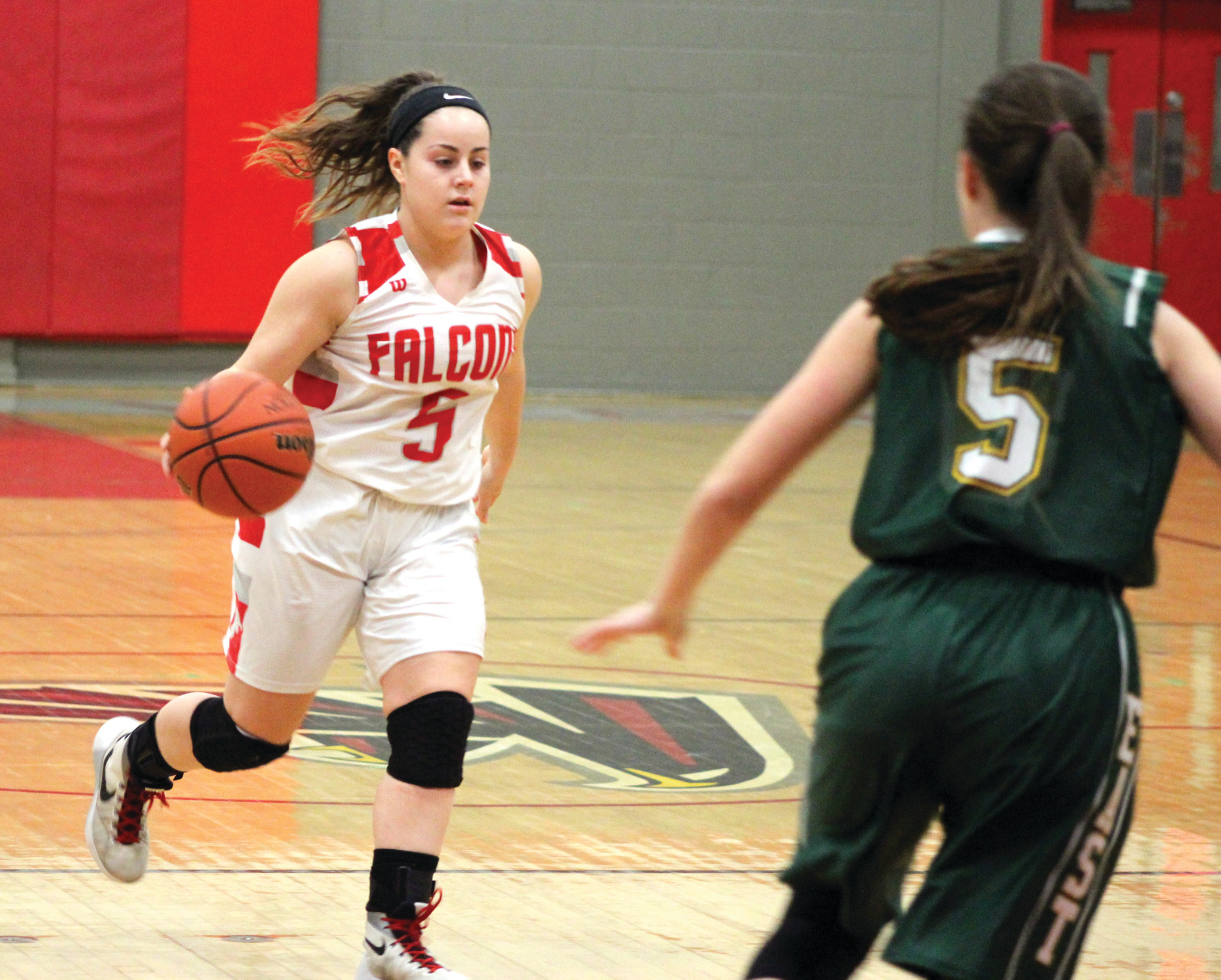FLOOR GENERAL: West point guard Abby Souza brings the ball past halfcourt as East's Shayna Cousineau waits to defend.