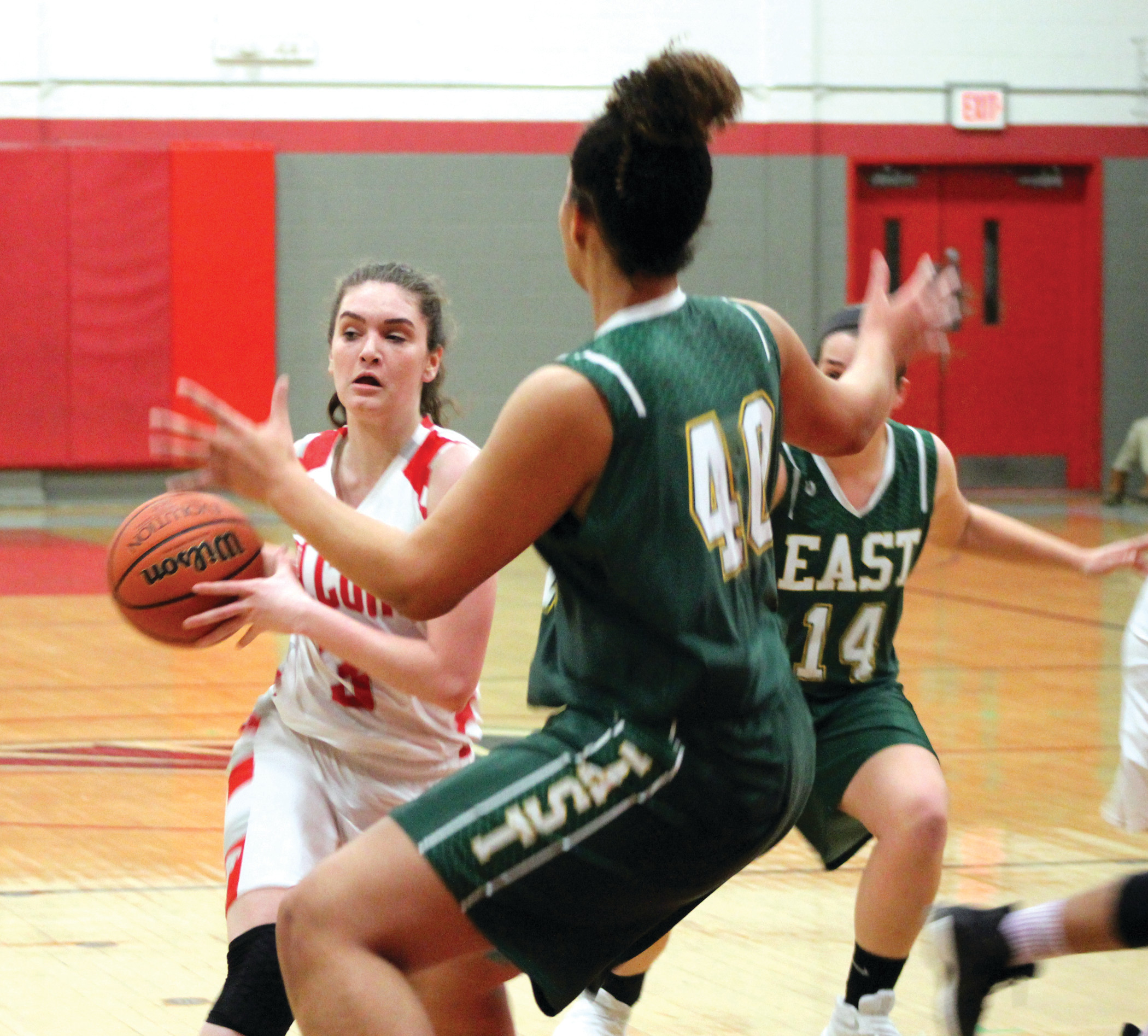 TALL TASK: West's Lauren Plociak drives to the basket against East center Maia Caito.