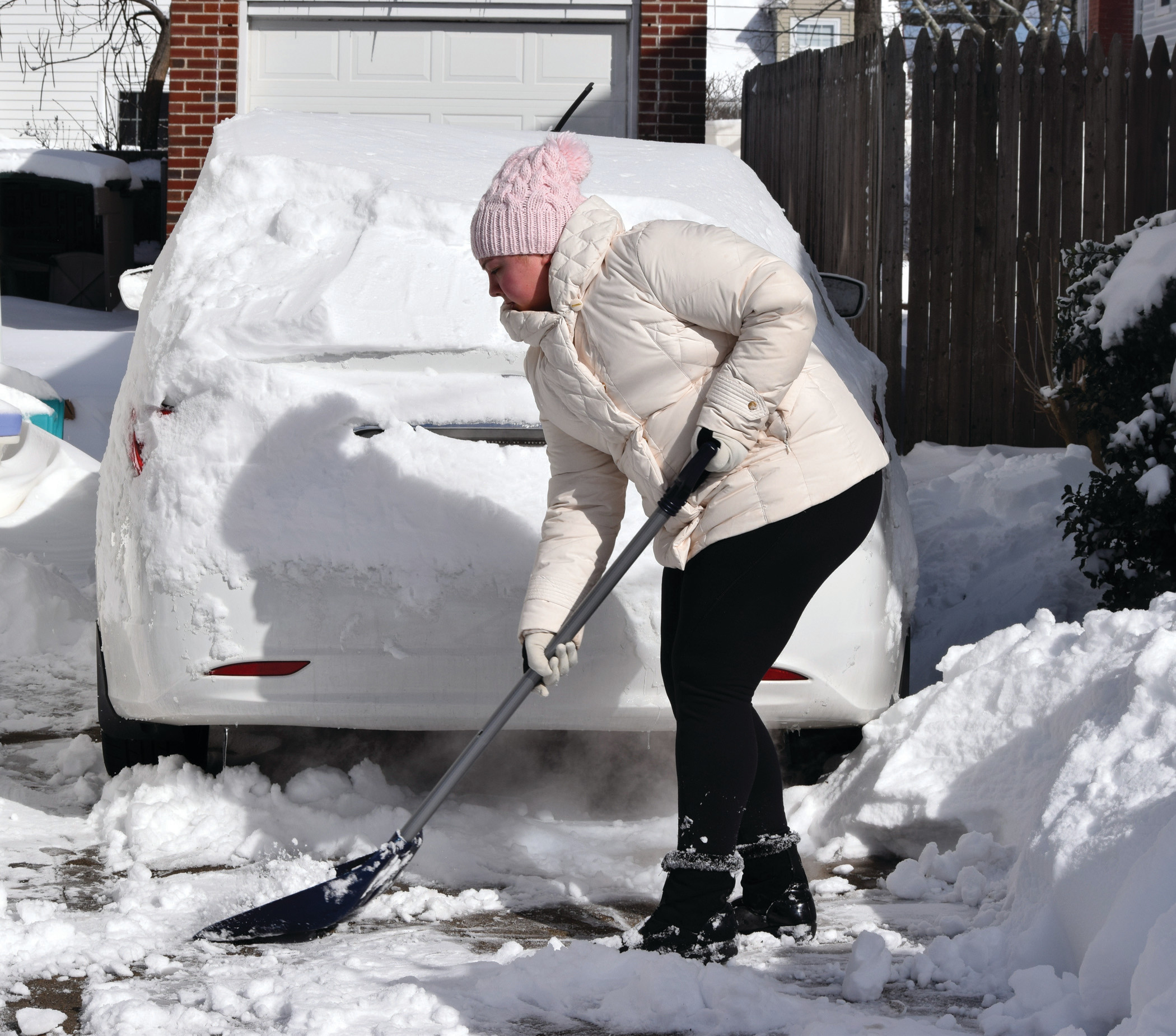 CLEARING THE WAY: Gianna Rotella, 20, shovels out her driveway on Friday morning.