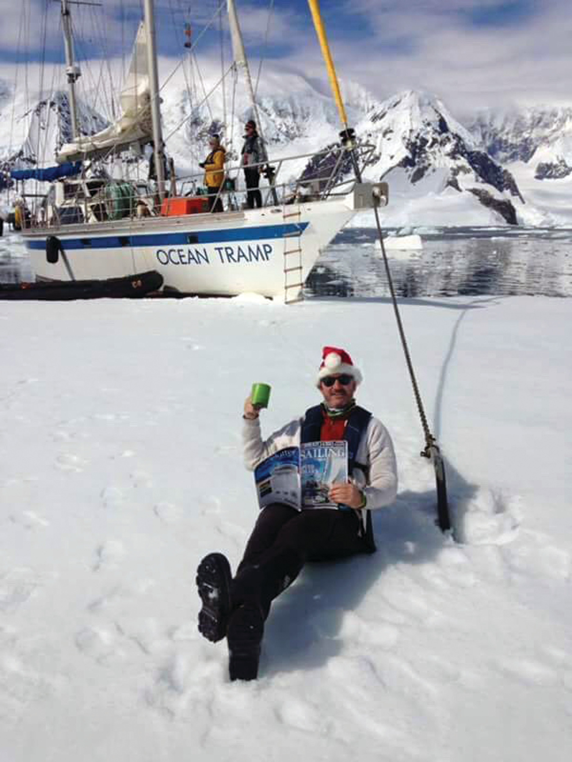 ENJOYING LIFE: Mellor enjoys a beverage while relaxing on the ice in Antarctica. He hopes to have visited 80 countries by the fourth year of his expedition.