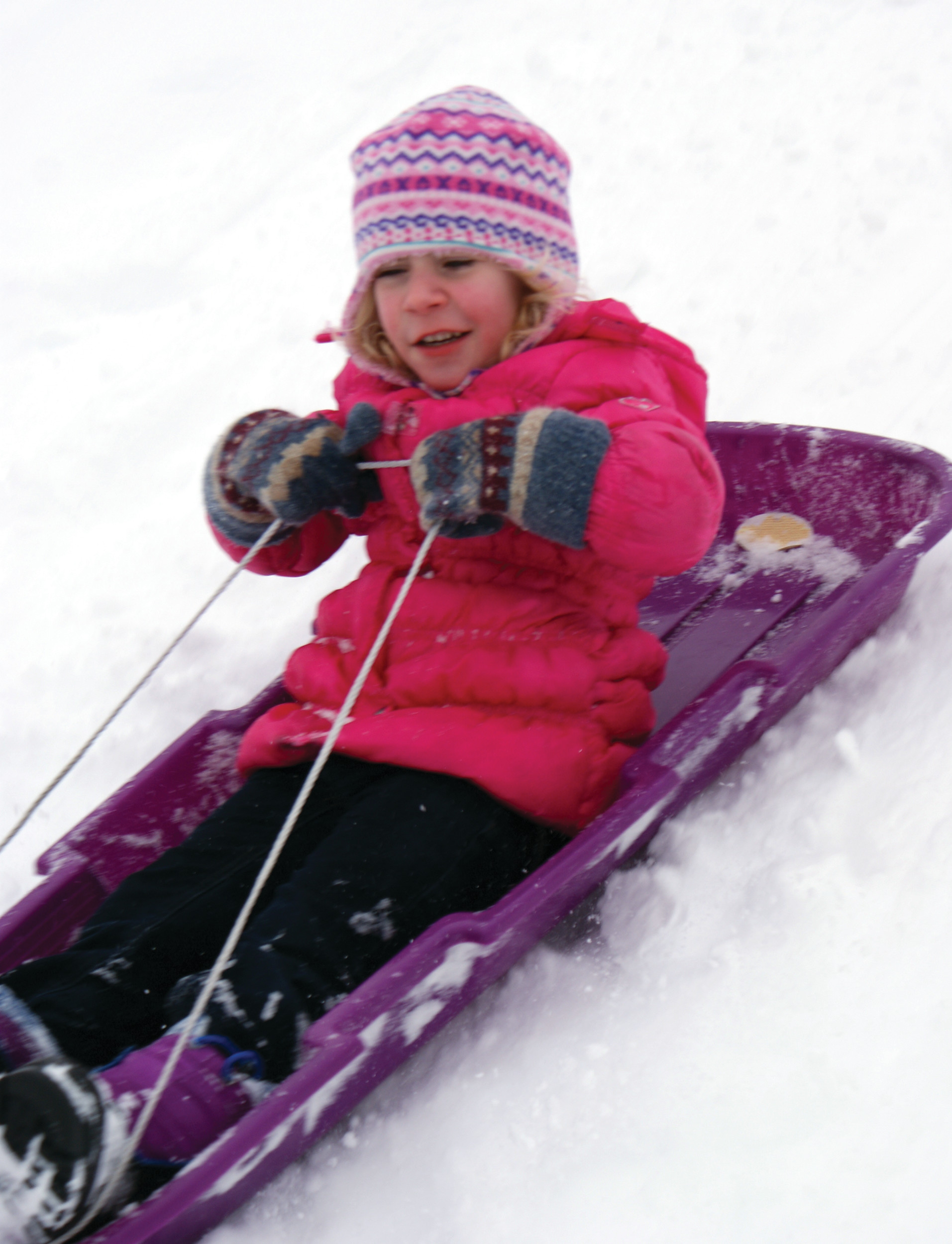 IN ACTION: Enjoying her day of sledding at Aqueduct Field was Victoria Olivieri, age 4, last Saturday.