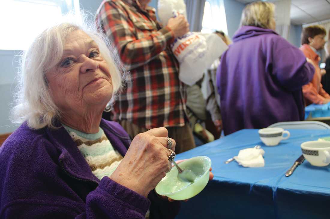 GOOD TO THE LAST SPOONFUL: Bonnie Brodeur enjoys coming to the lunch for the home-cooked food and the company.