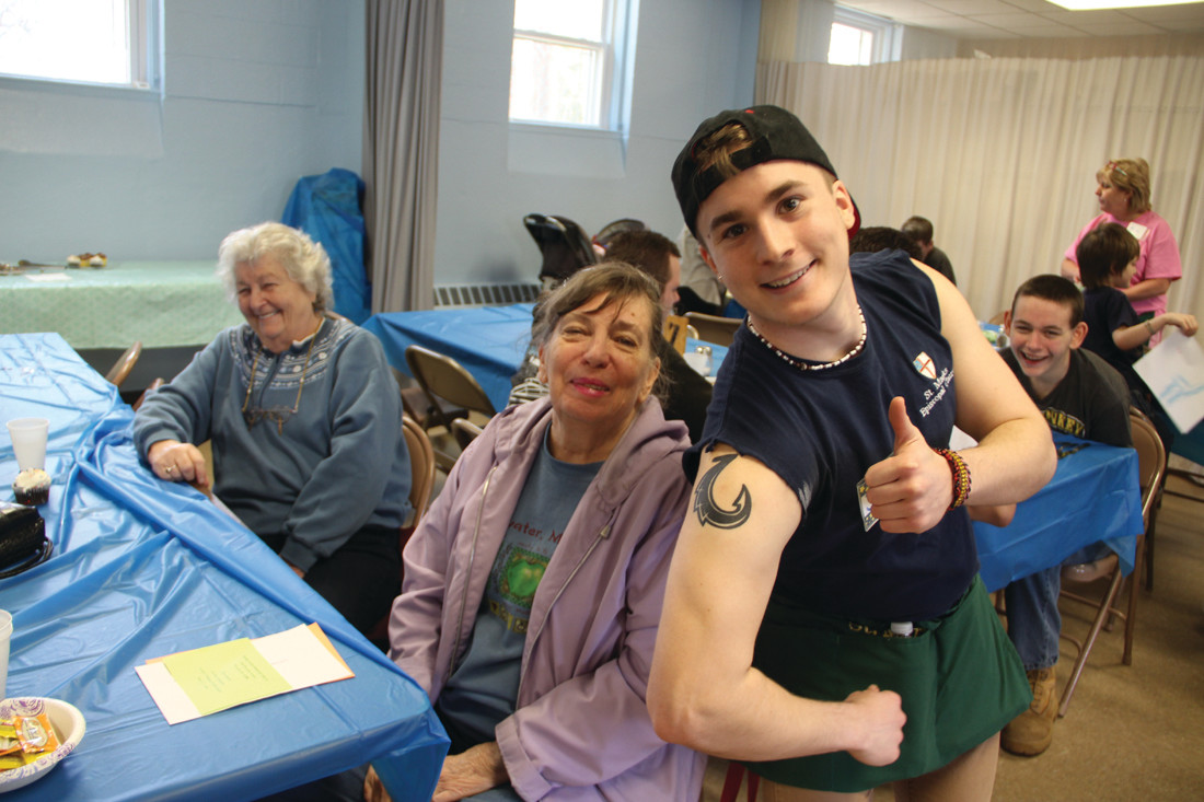 THEY'RE HOOKED: Mary Miller and Beth Roberts share a laugh with URI student and volunteer Jacob McNamara, who was delighted to show off his tattoo.