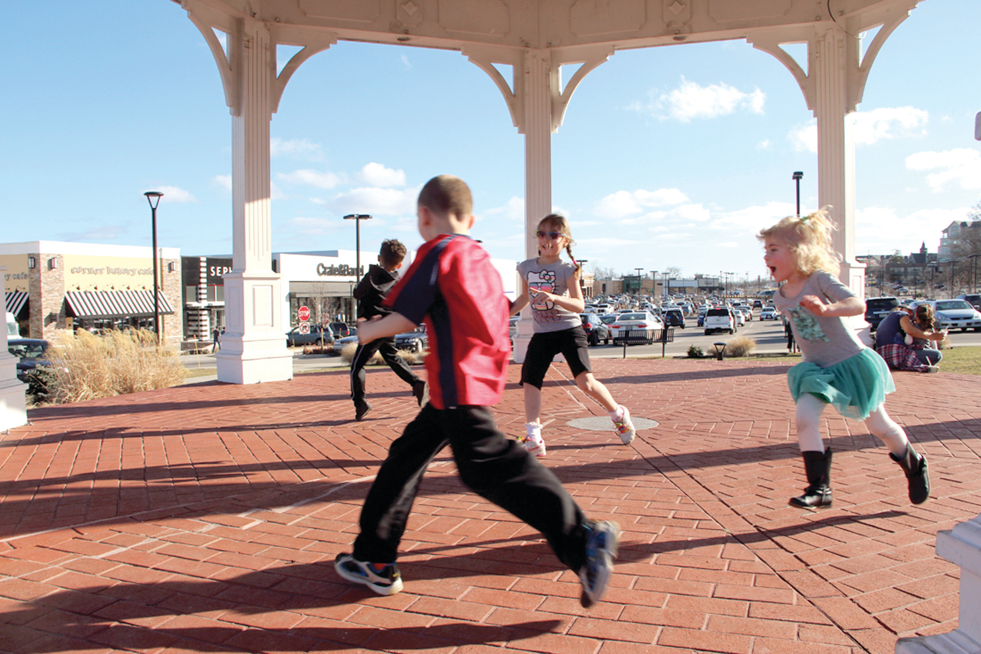 MAKING MOVES: Children play in the Gazebo at Garden City Center in this 2017 file photo. The shopping center has been sold to a Massachusetts developer for $181 million.
