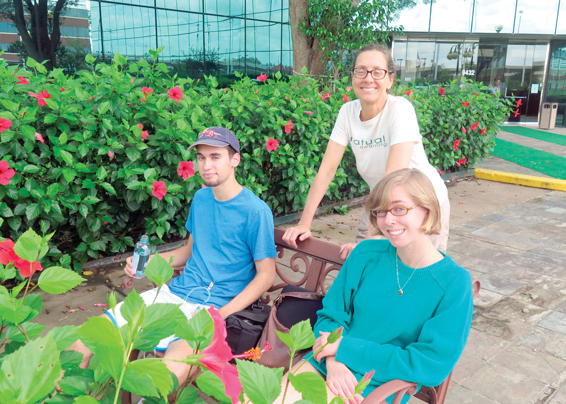 GETTING OUTSIDE: Neil, Evie and Wendy Fachon pictured in the clinic garden.