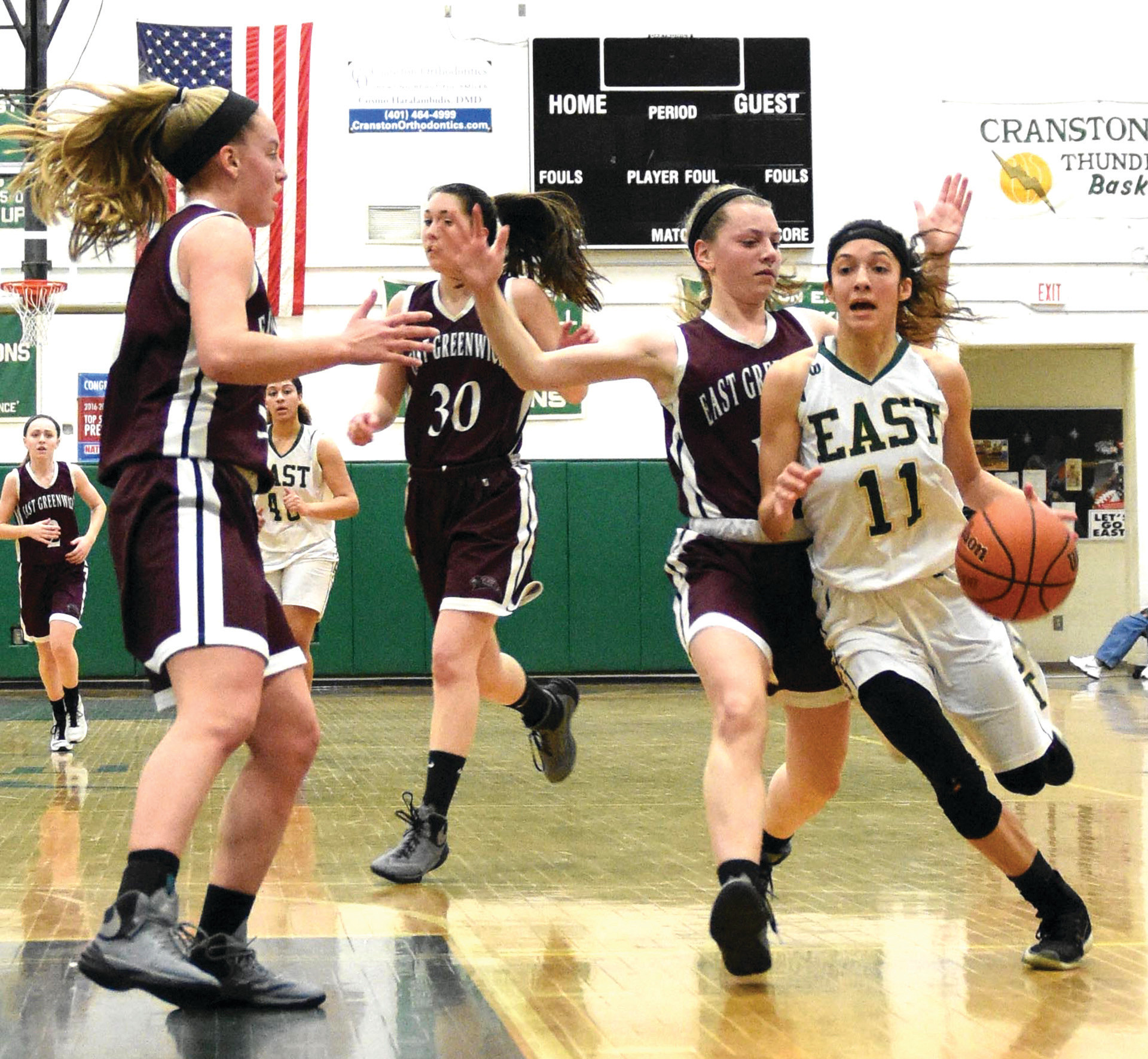 Sarah Coutu draws contact as she drives to the hoop.