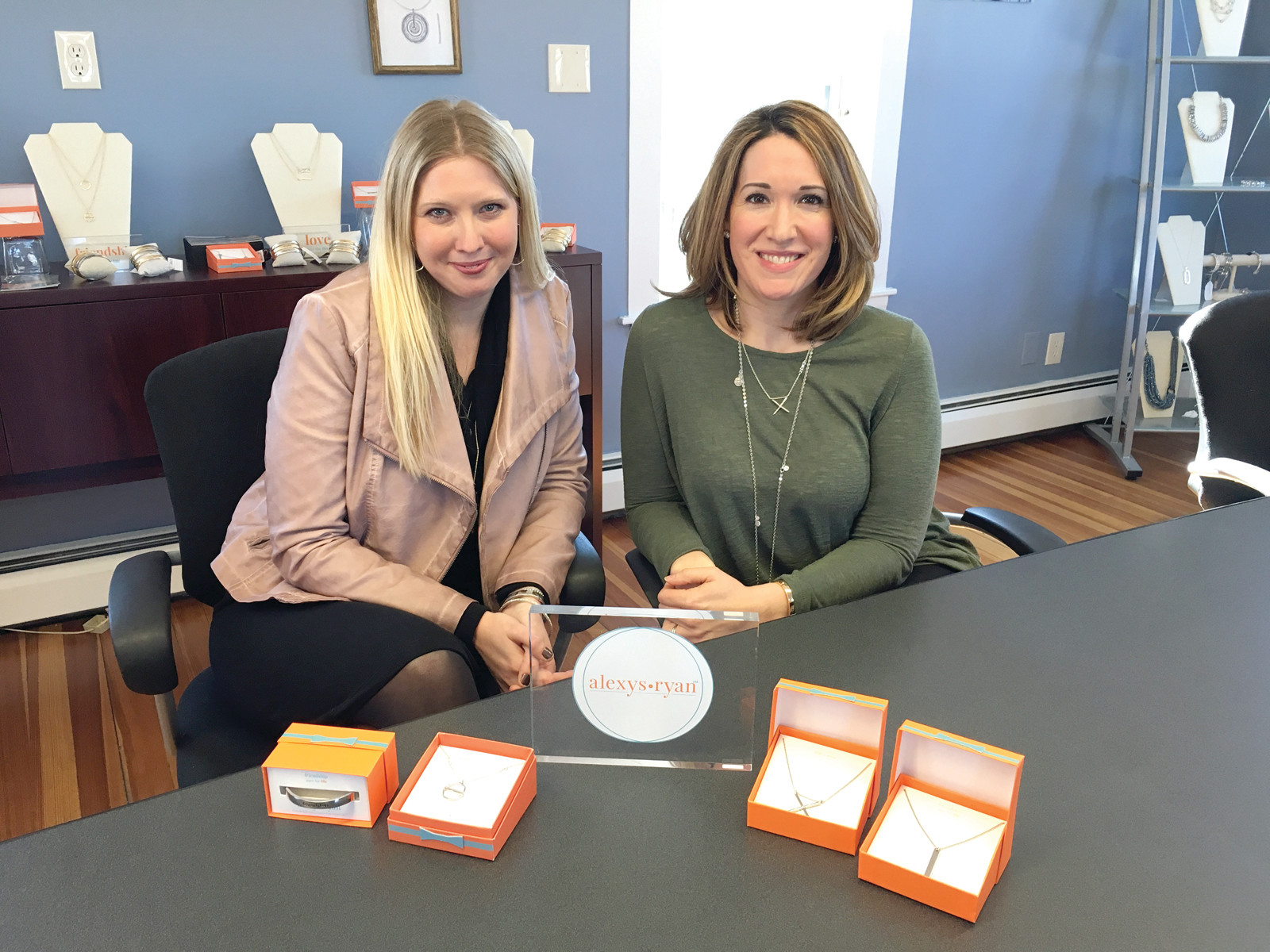 SISTERS IN LAW, BUSINESS PARTNERS: Alexys Garrepy of Warwick and Jennifer Brousseau of Cumberland are the creators of Alexys Ryan, LDC Inc.'s first original brand. Here, they display and are wearing some pieces of the jewelry line.