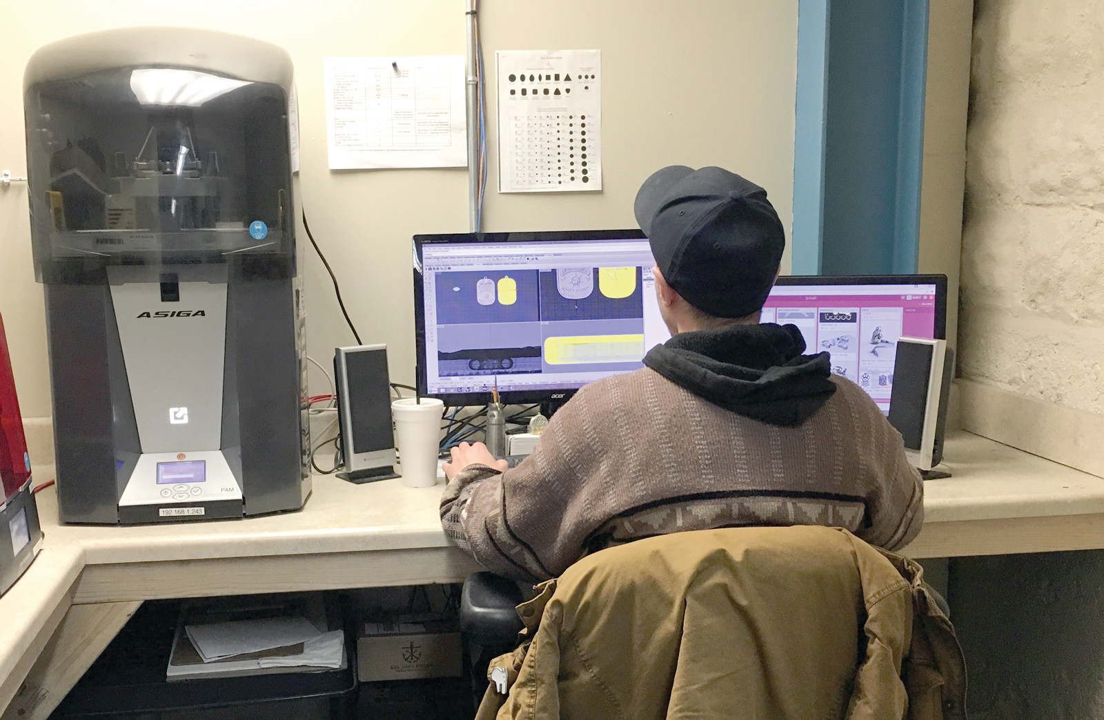 "HOW IT'S MADE: Scott Joinville, a 3D technician and model maker at LDC Inc., works at a 3D printer that makes parts of the Alexys Ryan line.  The line is designed and developed at LDC's East Providence location, and while jewelry is largely produced overseas, the combination of design and manufacturing expertise under one roof ""gives the company an added layer of quality control, making sure the customer is receiving the best product."""
