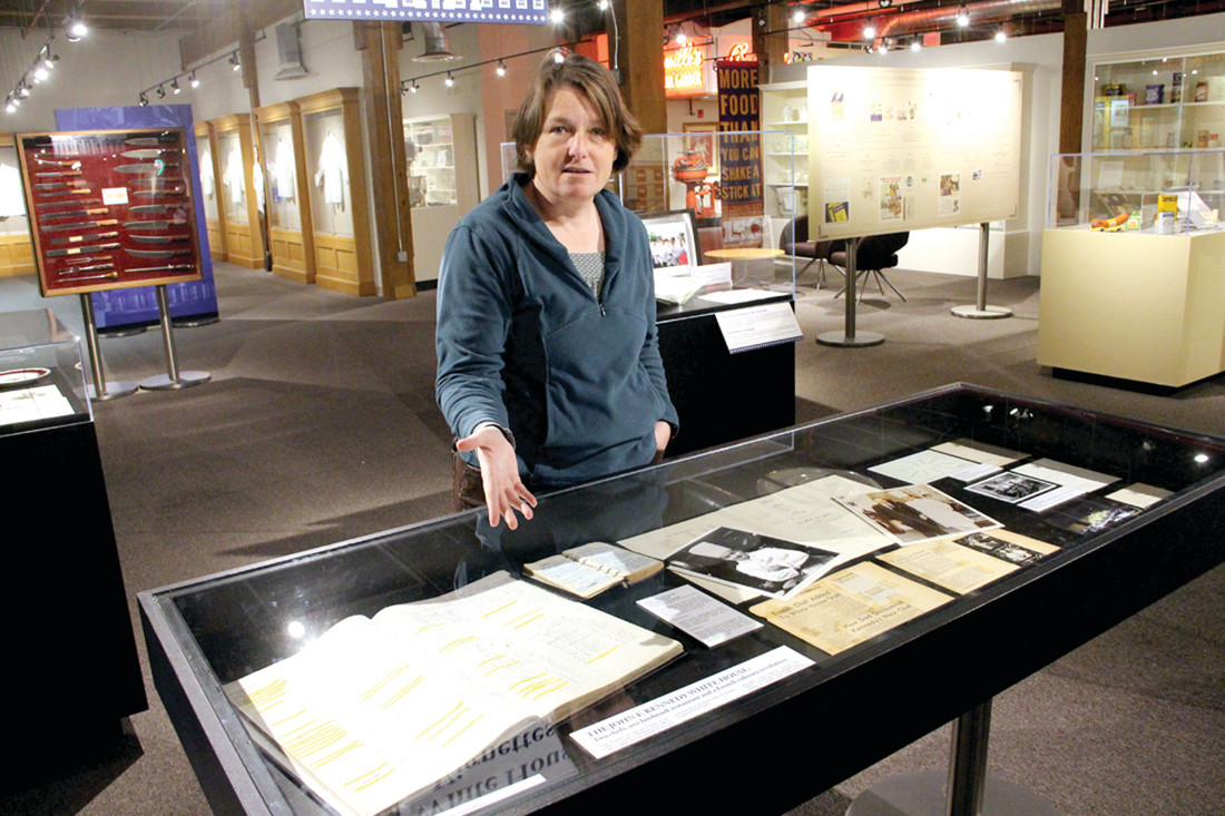THE STORY OF FOOD: Erin Williams, collections manager for the J& W Culinary Museum, relates how each display is designed to tell a story. Some display cases contain notes from chefs who have run the White House kitchen as well as menus and presidential letters.