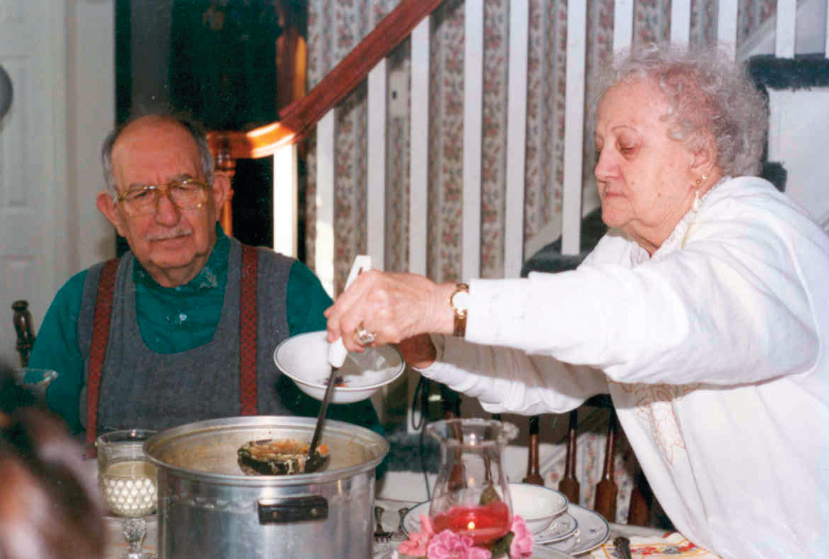 HER FAMOUS SOUP: Agnes dishes out a bowl of her soup, as her husband, Michael, looks on in this photo, which is believed to have been taken in 1996.