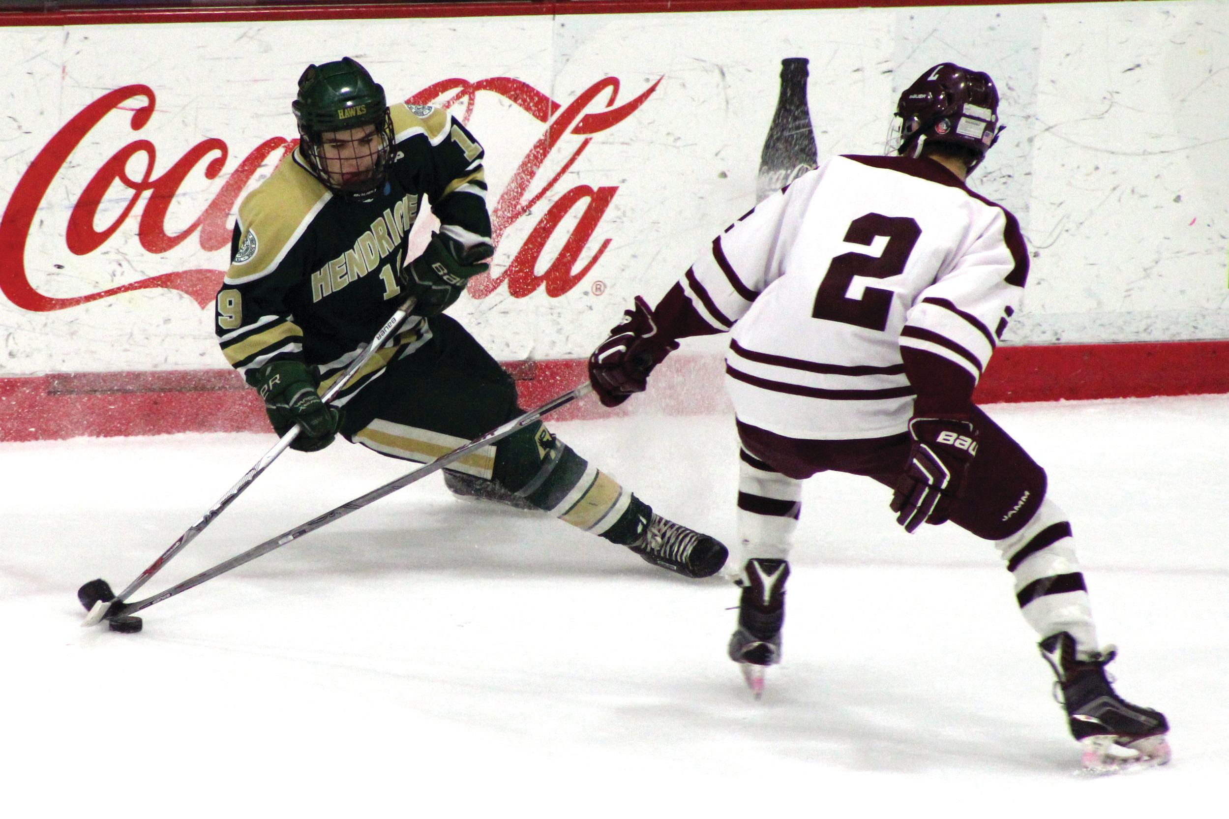 ATTACKING: Hendricken's Dan Cavanagh tries to cut to the middle of the ice against La Salle defenseman Matthew Murphy during Game 2.