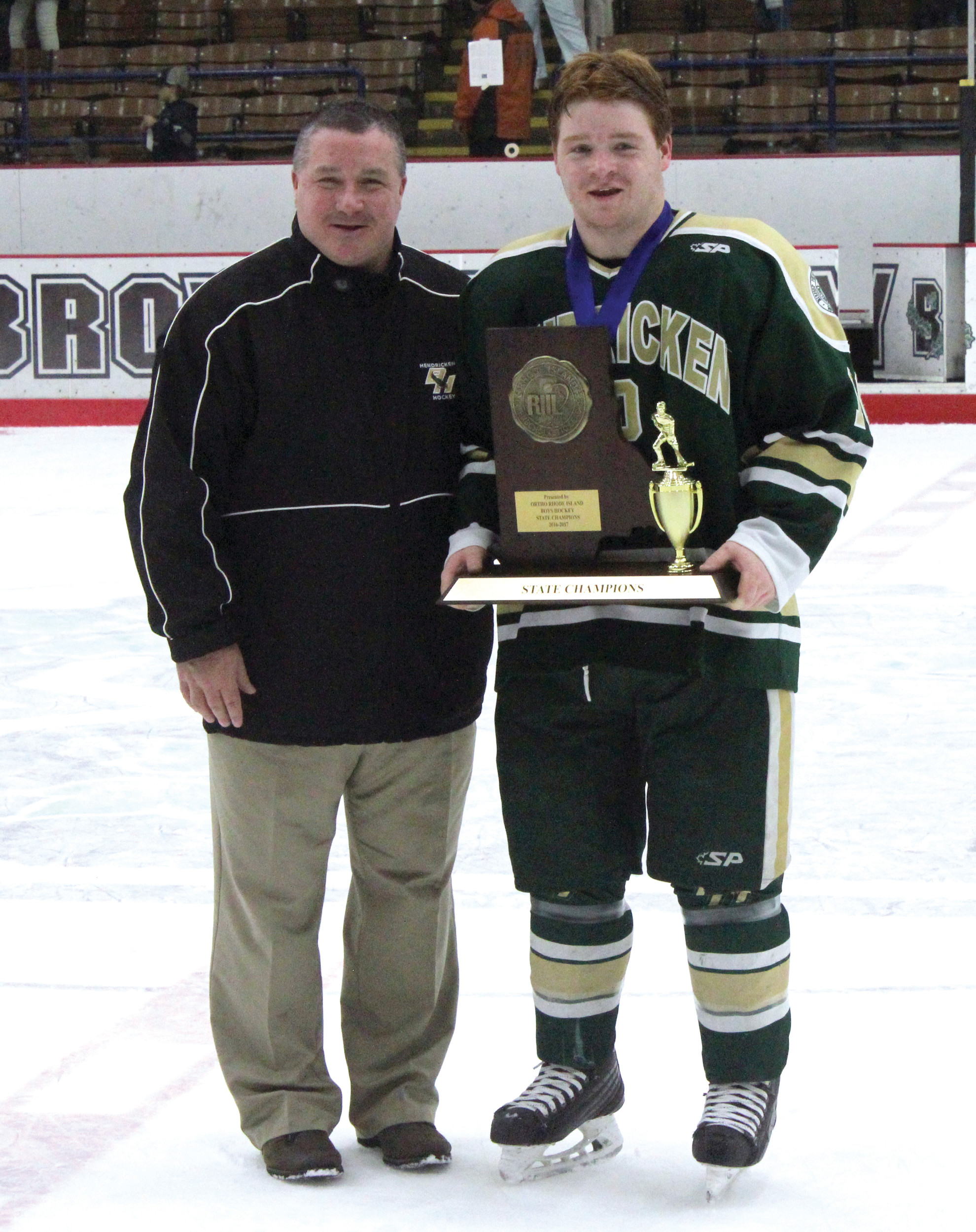 FAMILY EFFORT: Hendricken head coach Jim Creamer poses for a photo with his son Pat Creamer.