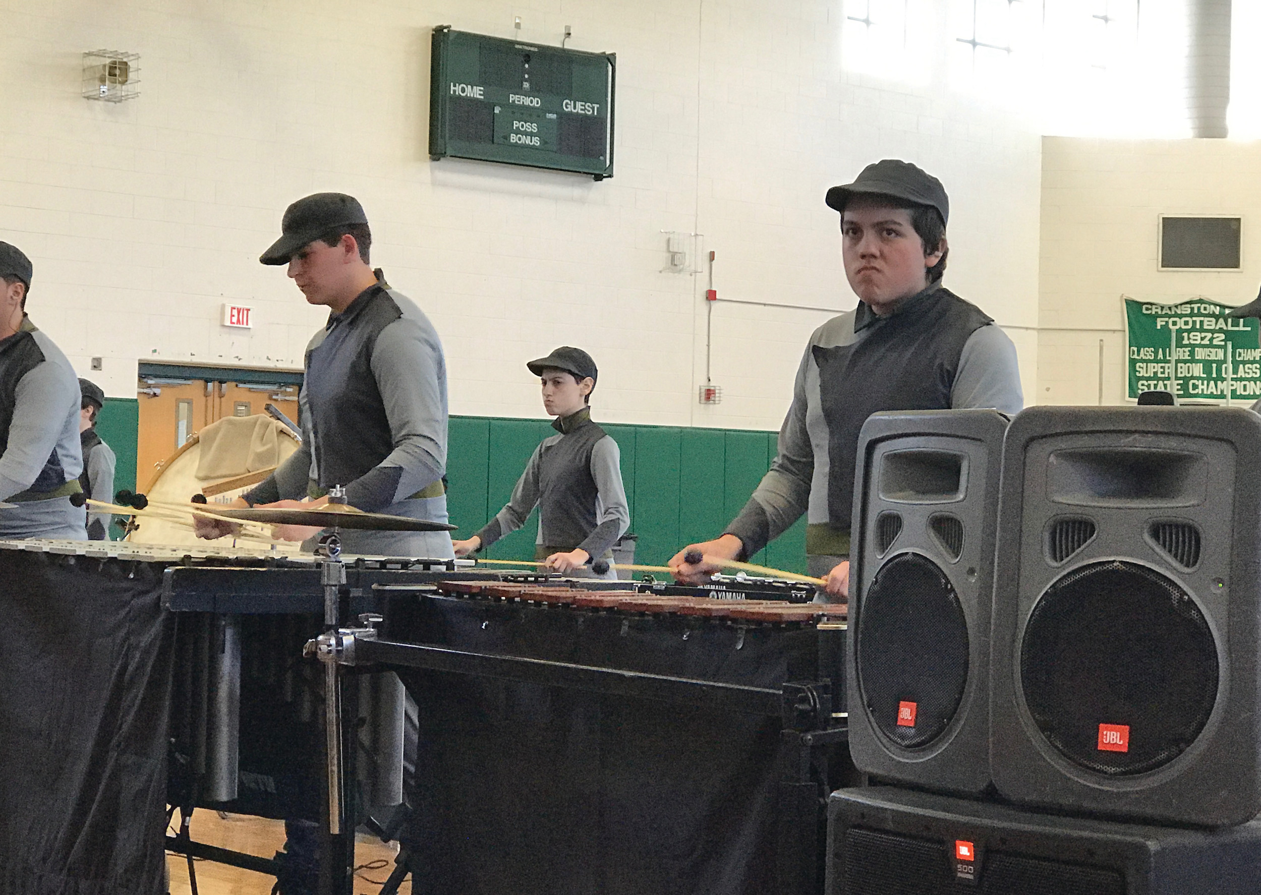"FACES OF AN UPRISING: Members of the front ensemble percussion show their stoic faces while performing ""Uprising"" at the Indoor Winter Percussion Competition on Sunday, March 12."