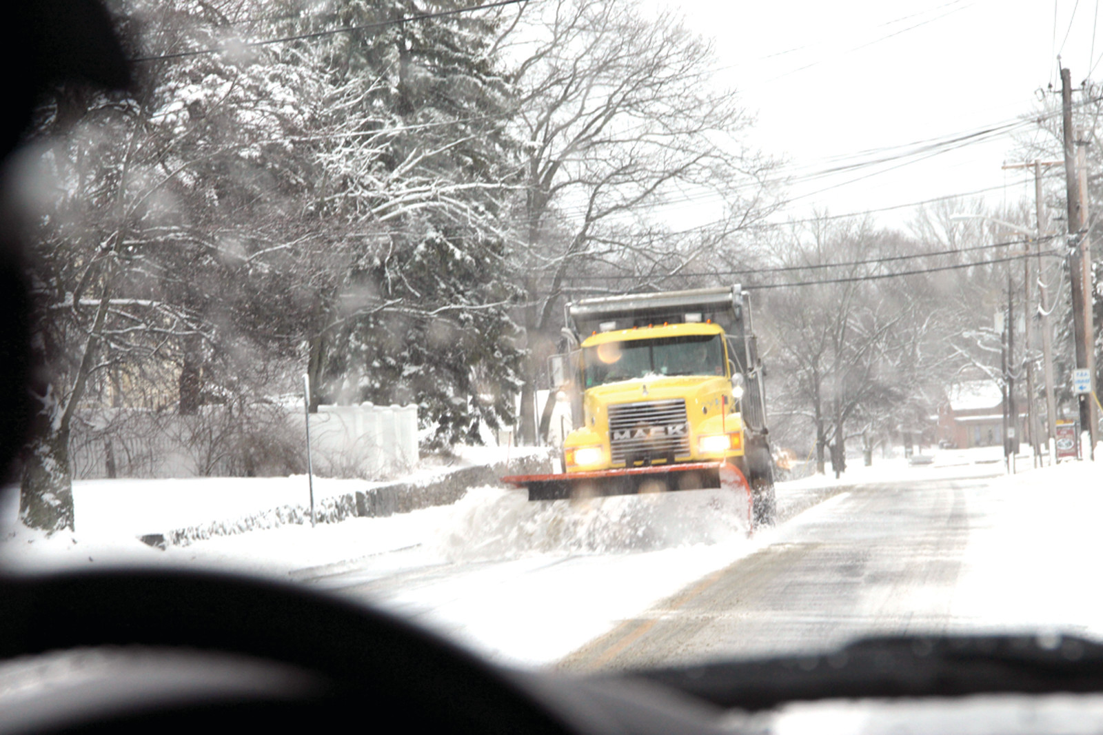 PRIORITY PLOWING: A city plow is assigned to keeping clear Toll Gate Road and Commonwealth Avenue, ensuring access to Kent Hospital. How the plow makes a pass on Toll Gate Road.