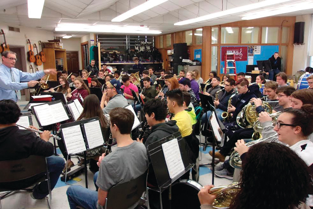 "PRECISION PRACTICE: JHS Music Department Chair Ronald Lamoureux puts the concert band through another practice in preparation for next Thursday's first-ever ""Festival Concert."""