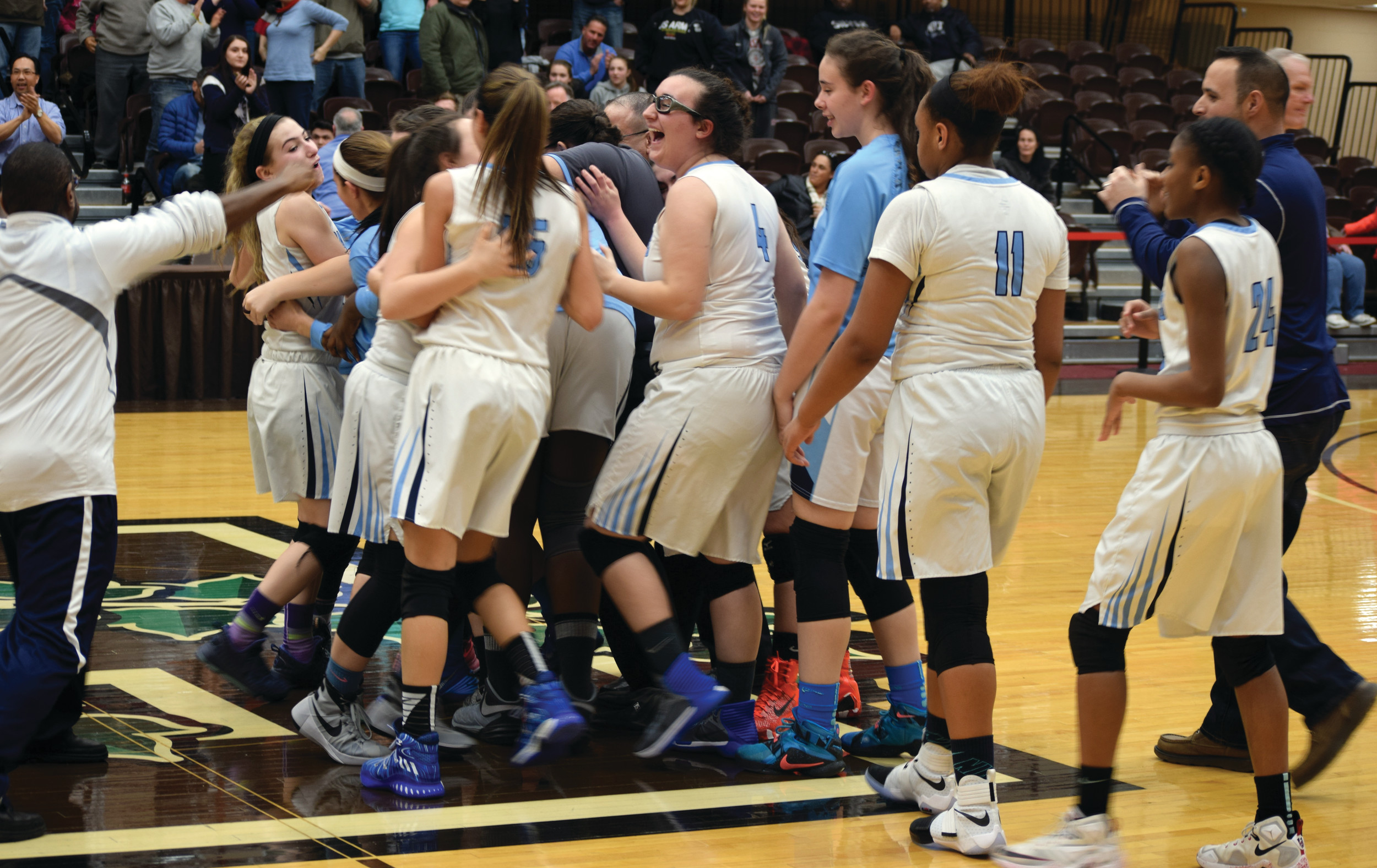 ADVANCING: The Johnston girls' basketball team celebrates at center court at Brown University after holding off Cranston East by two points in the Elite 8 on Saturday.
