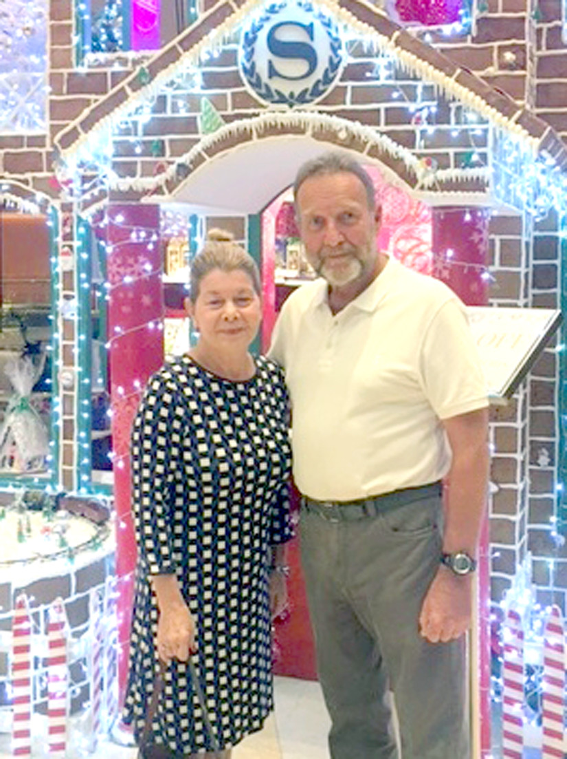 FINDERS OF THE TAGS: Pictured are Nolyine and Rick Brittain, which was taken on Christmas Day at the Sheraton Hotel in Ho Chi Minh City. The couple recently found American dog tags while on vacation, and are attempting to contact families with the hopes of returning them home. (Submitted photo)