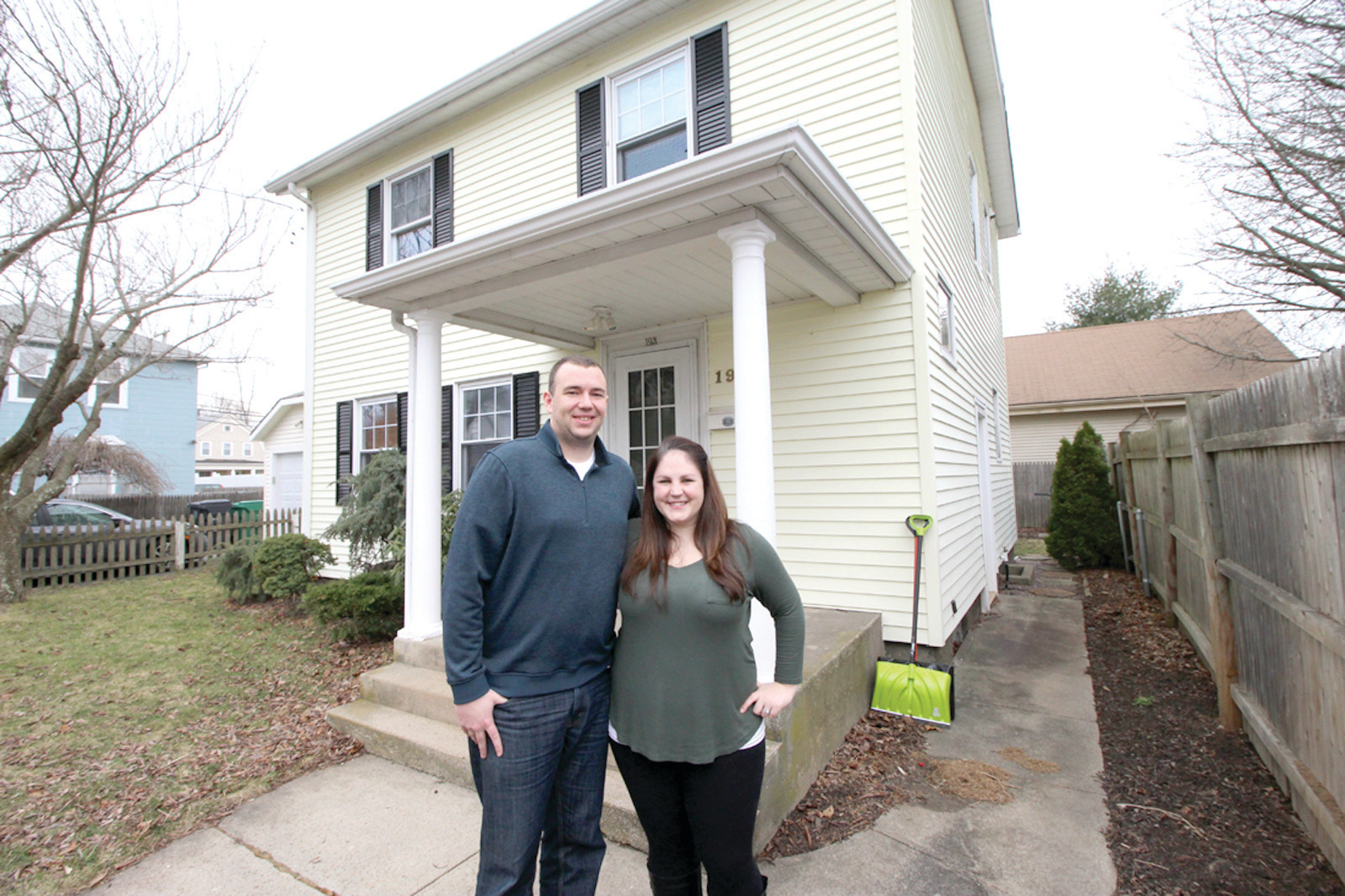 FIRST TIME HOME BUYERS: Greg and Taylor Flynn outside the home they bought last year.