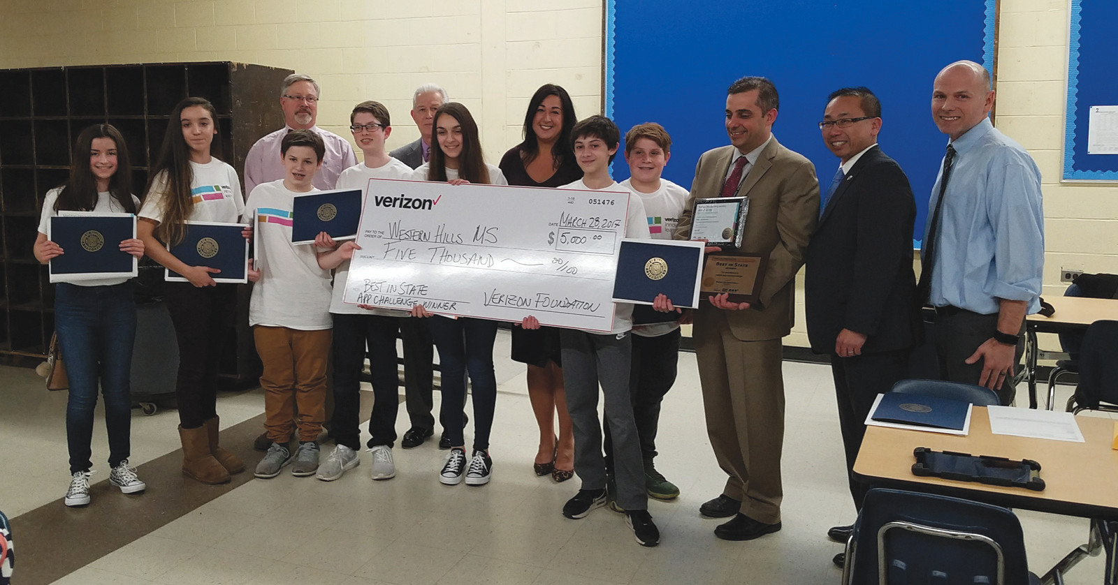 A BIG CHECK: The Verizon App Challenge winners enjoyed taking a photo with their giant award check. The team earned money for their school, their advisors and received tablets and t-shirts from Verizon as their prize. During the ceremony they were given citations from the State House and from the City of Cranston. (Herald photo by Jen Cowart) The Lexus Eco Challenge winners were given special citations from the State House during the awards ceremony and are seen here posing with Cranston's Mayor Allan Fung.