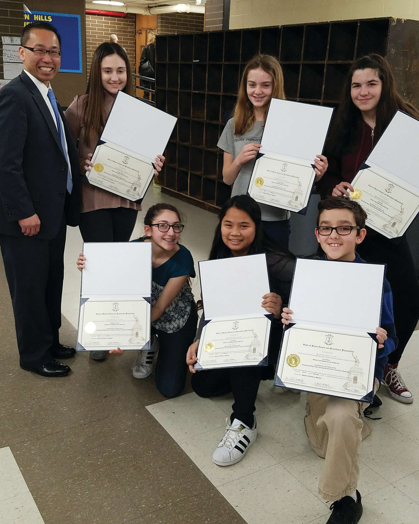 HONORED: The Lexus Eco Challenge winners were given special citations from the State House during the awards ceremony and are seen here posing with Cranston's Mayor Allan W.  Fung.