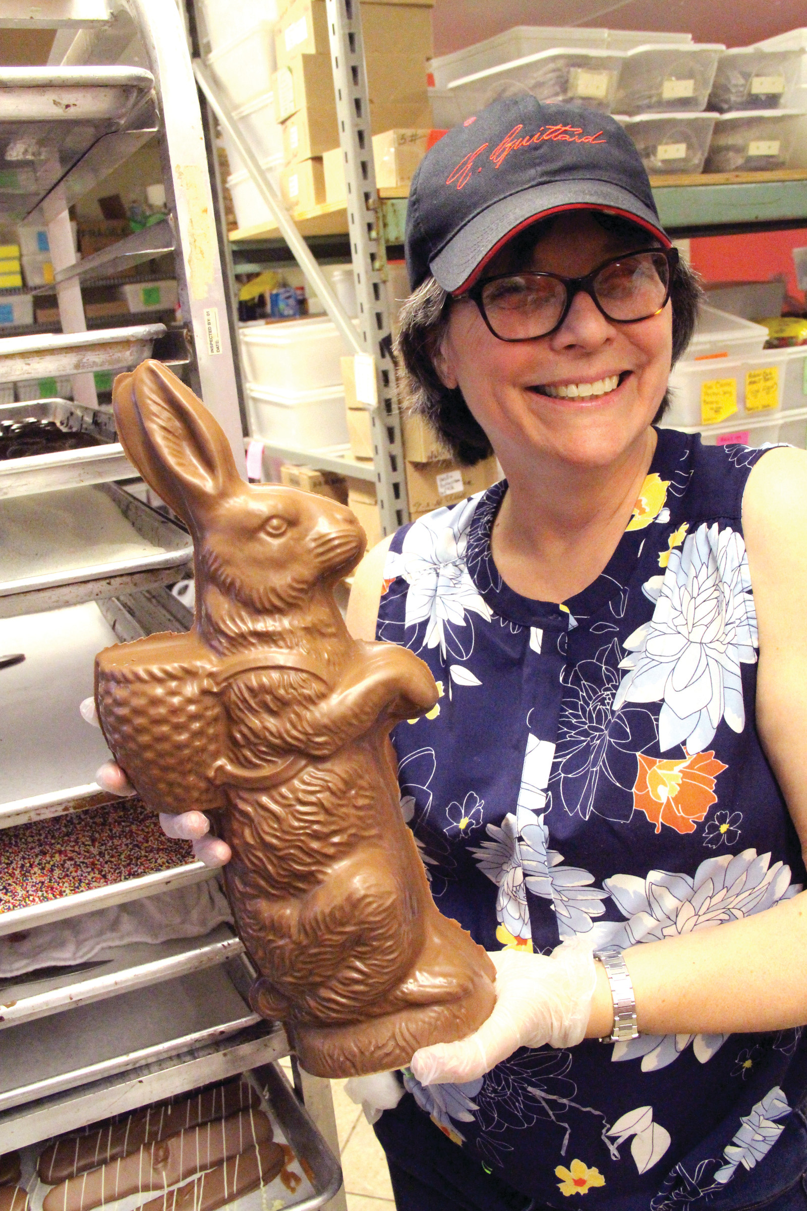 SUPER SIZED: Marie Schaller holds up the largest bunny they make. It's 17 inches high and tilts the scale at 2.5 to 3 pounds.