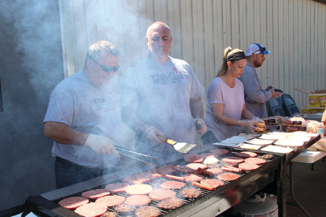 SMOKING: A crew from the Knights of Columbus provided an extra benefit for the 30th Oakland Beach Association Easter egg hunt, providing hot dogs and hamburgers.