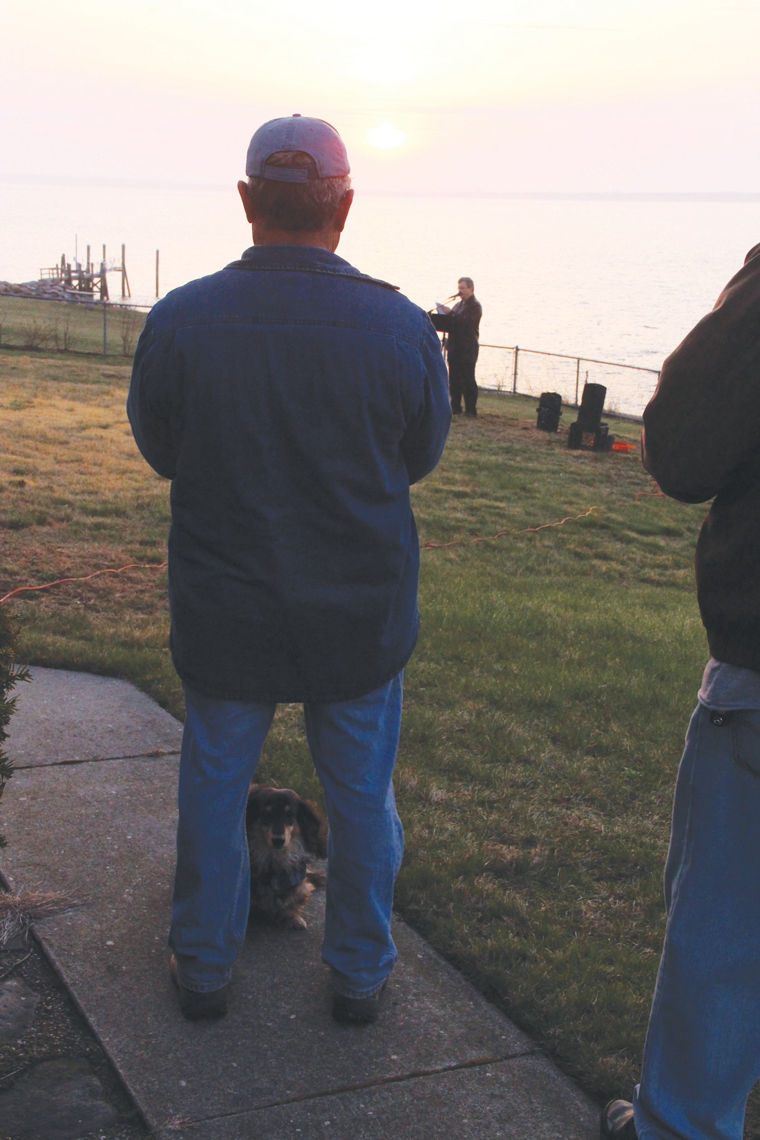 SUNRISE REGULAR: Ron Caniglia and his companion at the Easter sunrise service at Warwick Light.