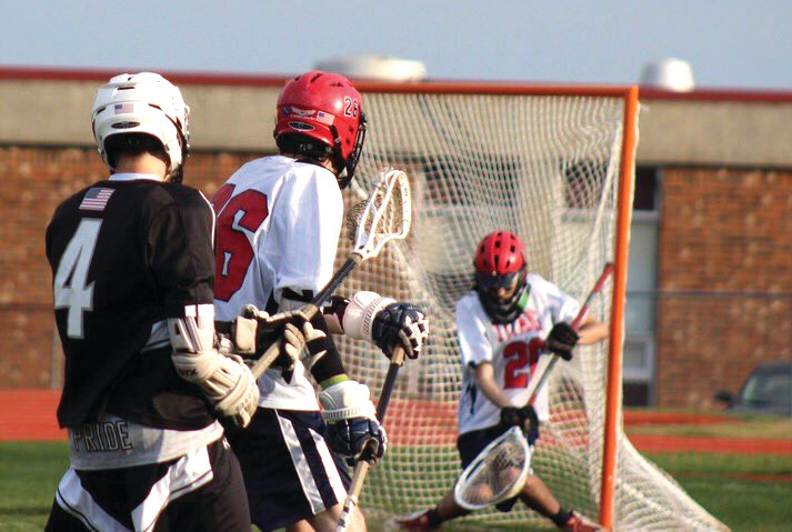 GAME-WINNER: Pilgrim's Pat Reilly fires a shot to the back of the net in overtime on Wednesday.