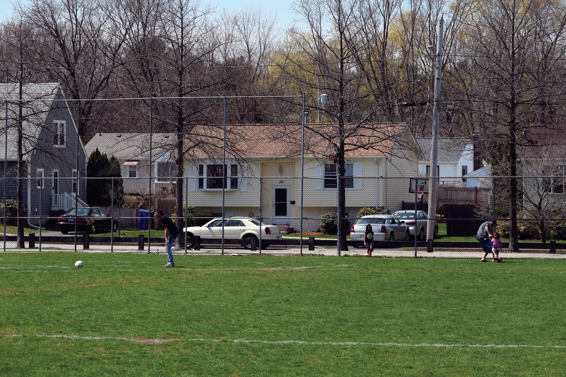 Residents enjoy the nice Saturday weather on the field.