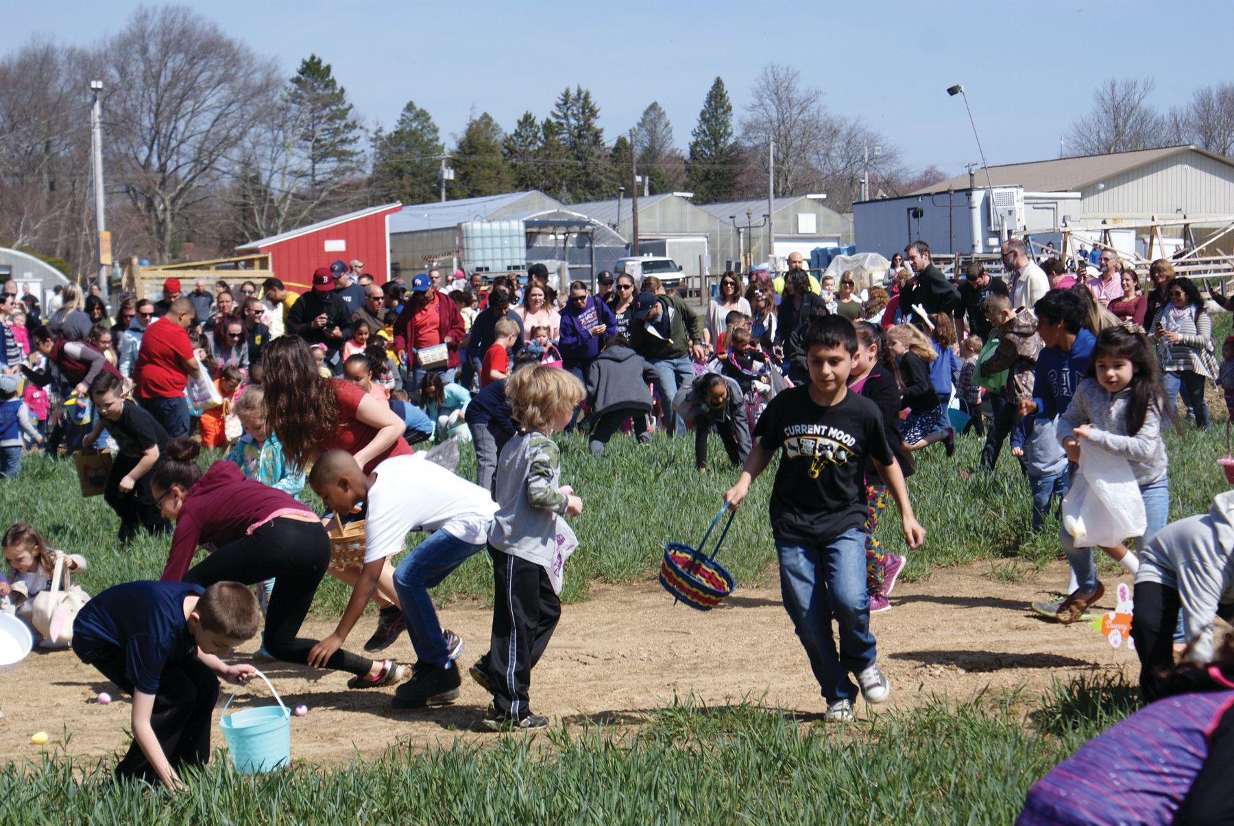 ON THE HUNT: Hundreds of children and their families turned out for the Annual Confreda Farms Easter Egg Hunt on April 15. For the second year in a row, the event was sponsored by Cox Cable. Each participating child received a bag of candy in exchange for the eggs they found.
