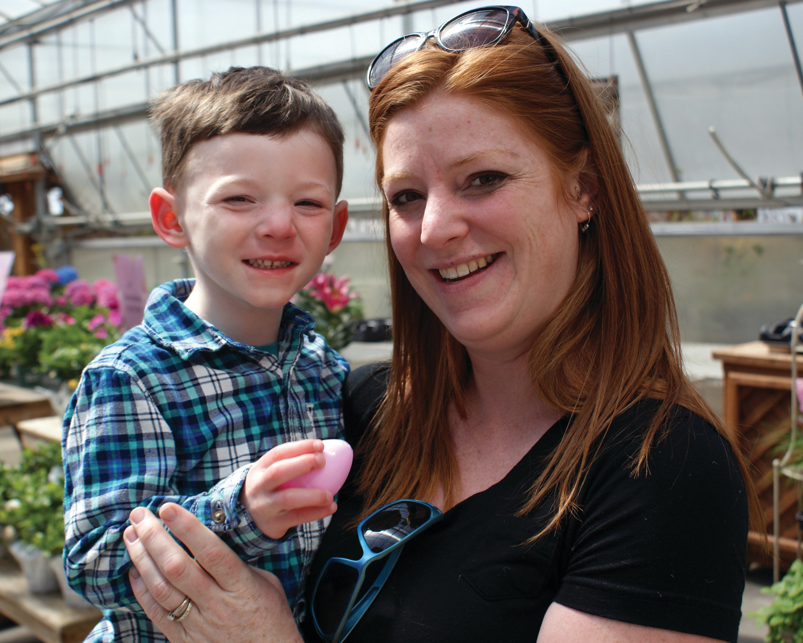 ALL SMILES: Pictured is Brayden Marcoux, age 3, with his mother, Aubrie, inside the Confreda Farms Greenhouse after the Annual Confreda Farms Easter Egg Hunt on April 15.