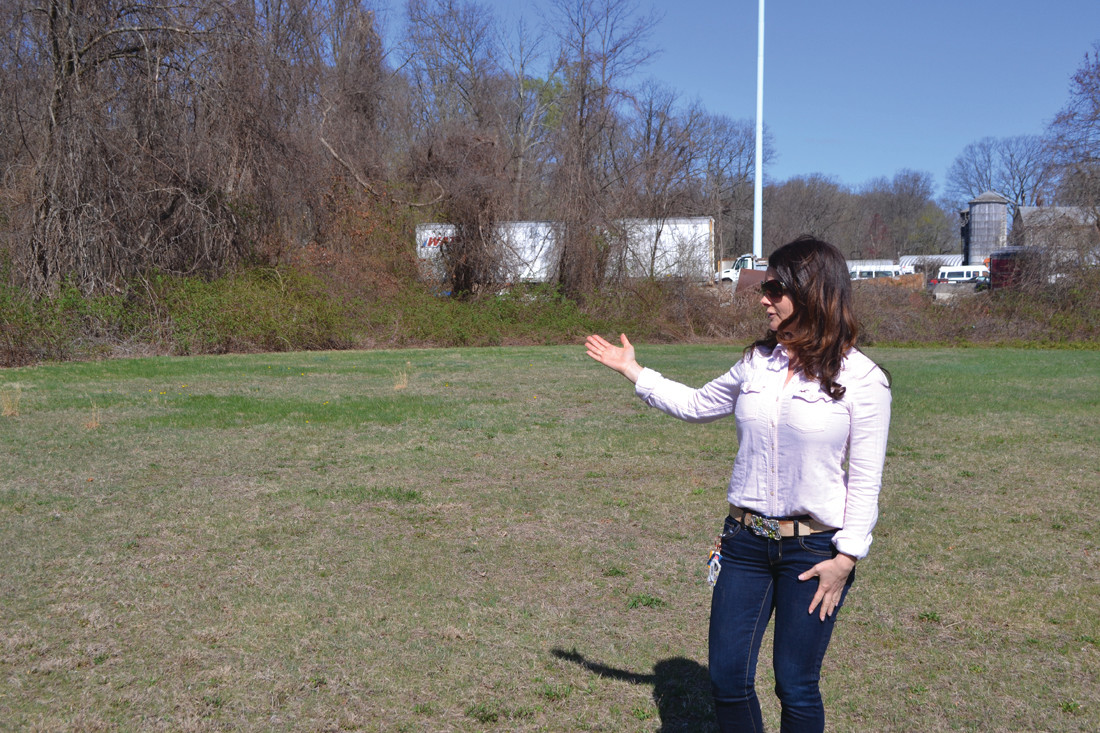 OUTDOOR LEARNING: Barnes Principal Jill Souza points out where the school's new outdoor classroom will be placed. The school recently received approval and a $3,000 grant to begin the project.